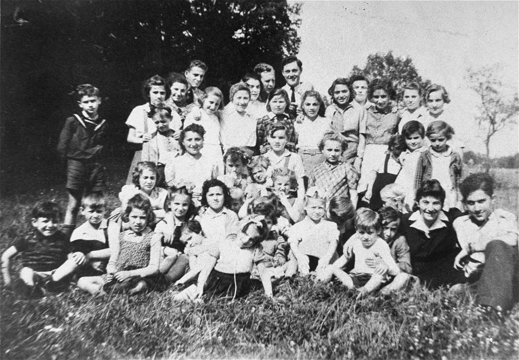 A group photograph of children in the Bergen-Belsen displaced persons' camp in 1946.