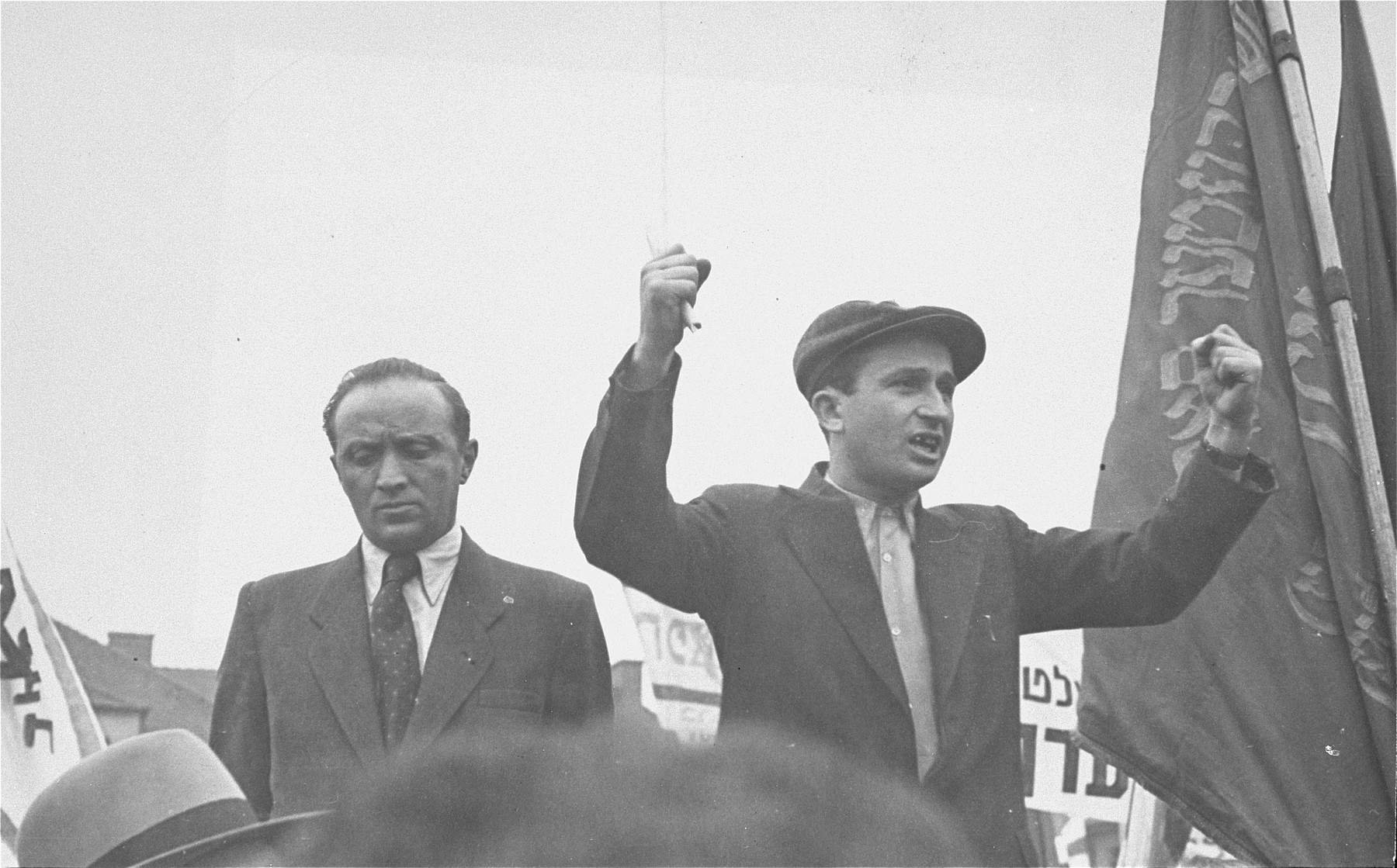 Ephraim Londner raises clenched fists during his speech at a demonstration protesting the return of the Exodus 1947 passengers to Germany at the Bergen-Belsen displaced persons camp.    Standing next to Londner is Josef Rosensaft, chairman of the Central Jewish Committee for the British Zone.