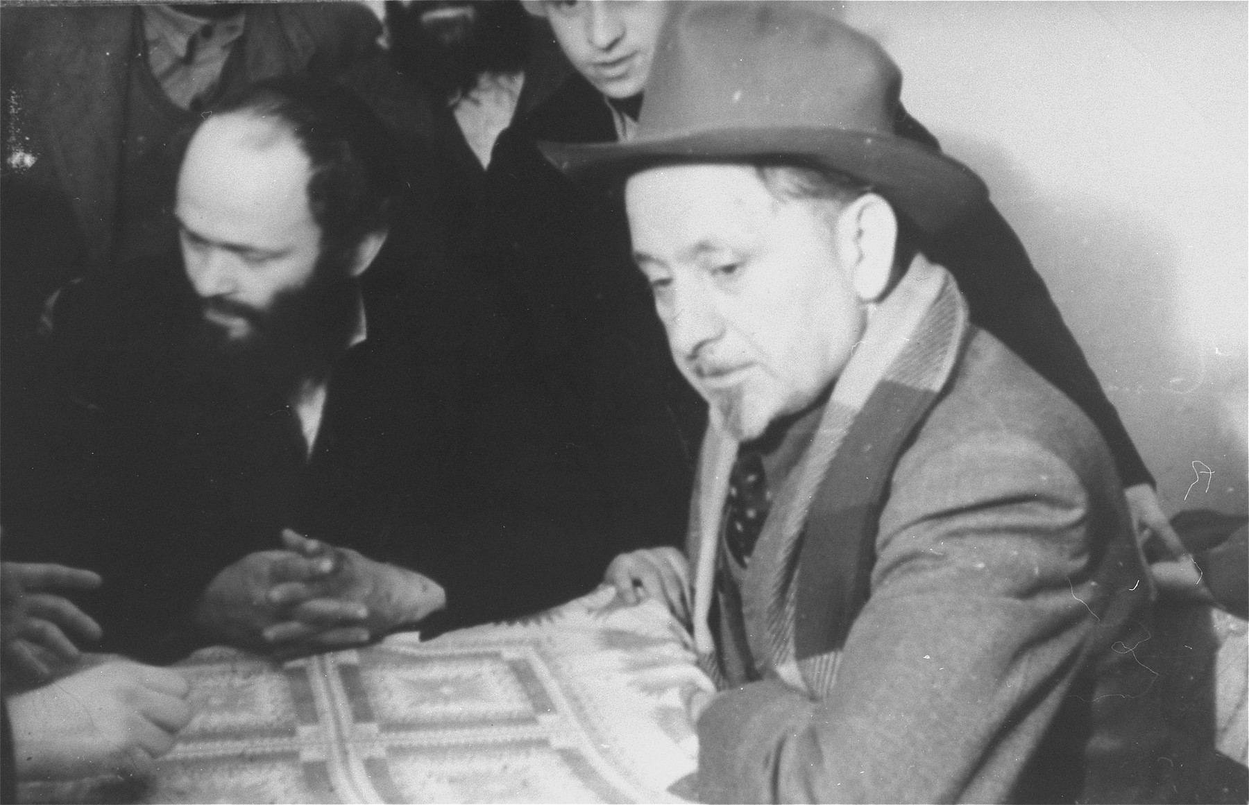 Yeshiva students gather together around a table in the Zeilsheim displaced persons' camp.