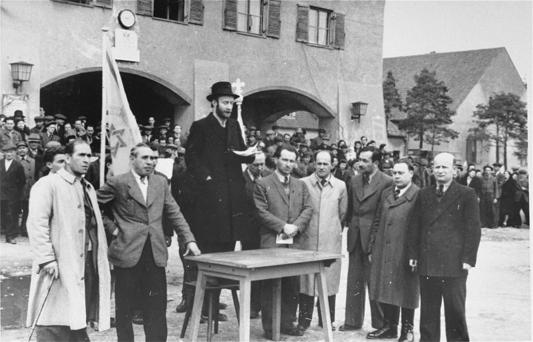 A Hungarian rabbi speaks at a demonstration in Foehrenwald displaced persons camp.    The DPs are protesting against the death sentence meted out by the British authorities in Palestine, to Dov Gruner, for bombing the King David Hotel in Jerusalem.