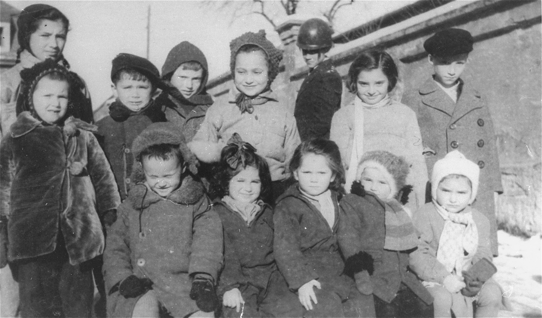 Group portrait of children in the Zeilsheim DP camp.  Henia Wisgardisky is pictured third from the right in the front row.  Her cousin, Bluma Berk, is seated fourth from the right.