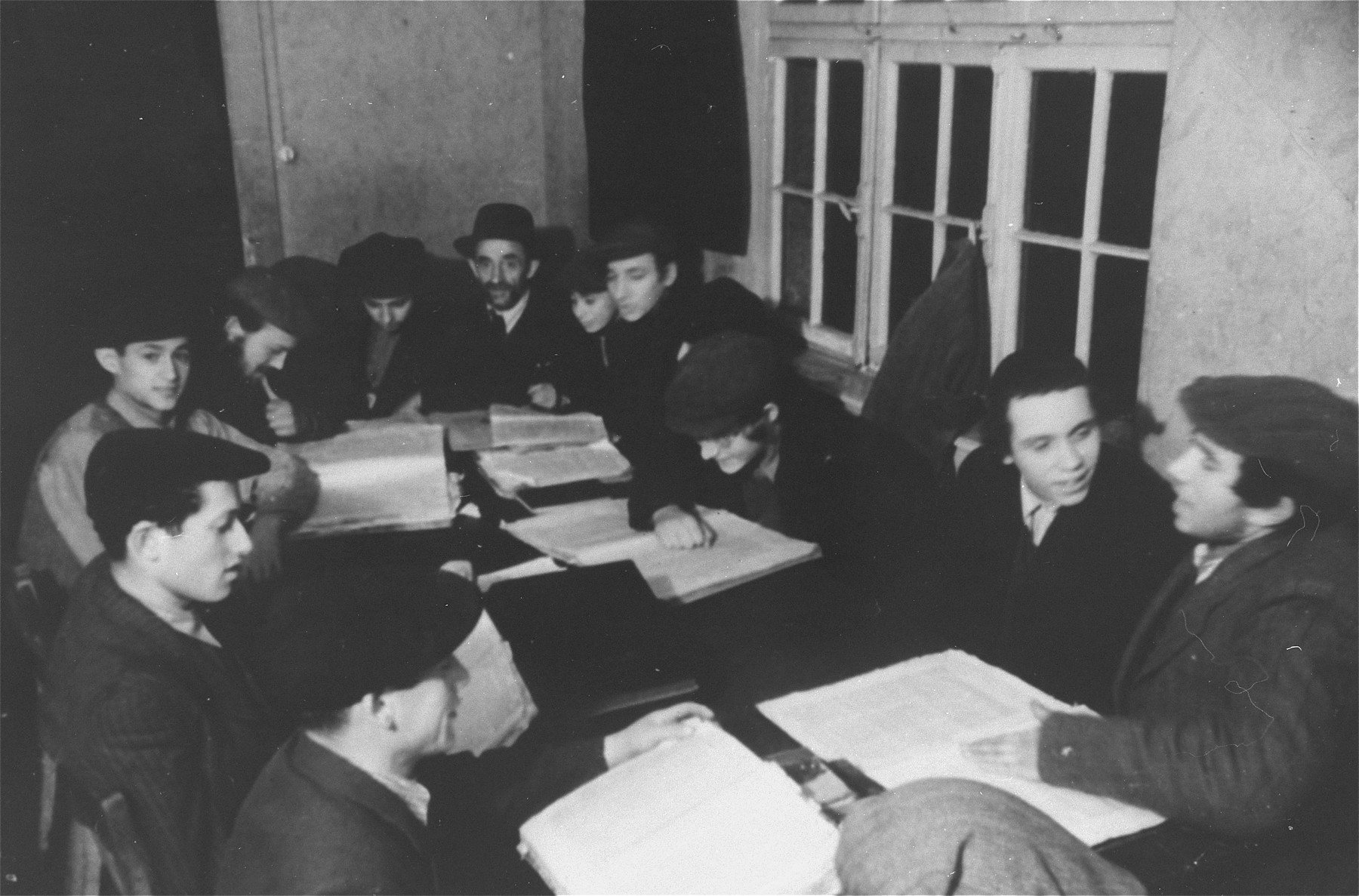 Students study Talmud at a Yeshiva in the Zeilsheim displaced persons' camp.