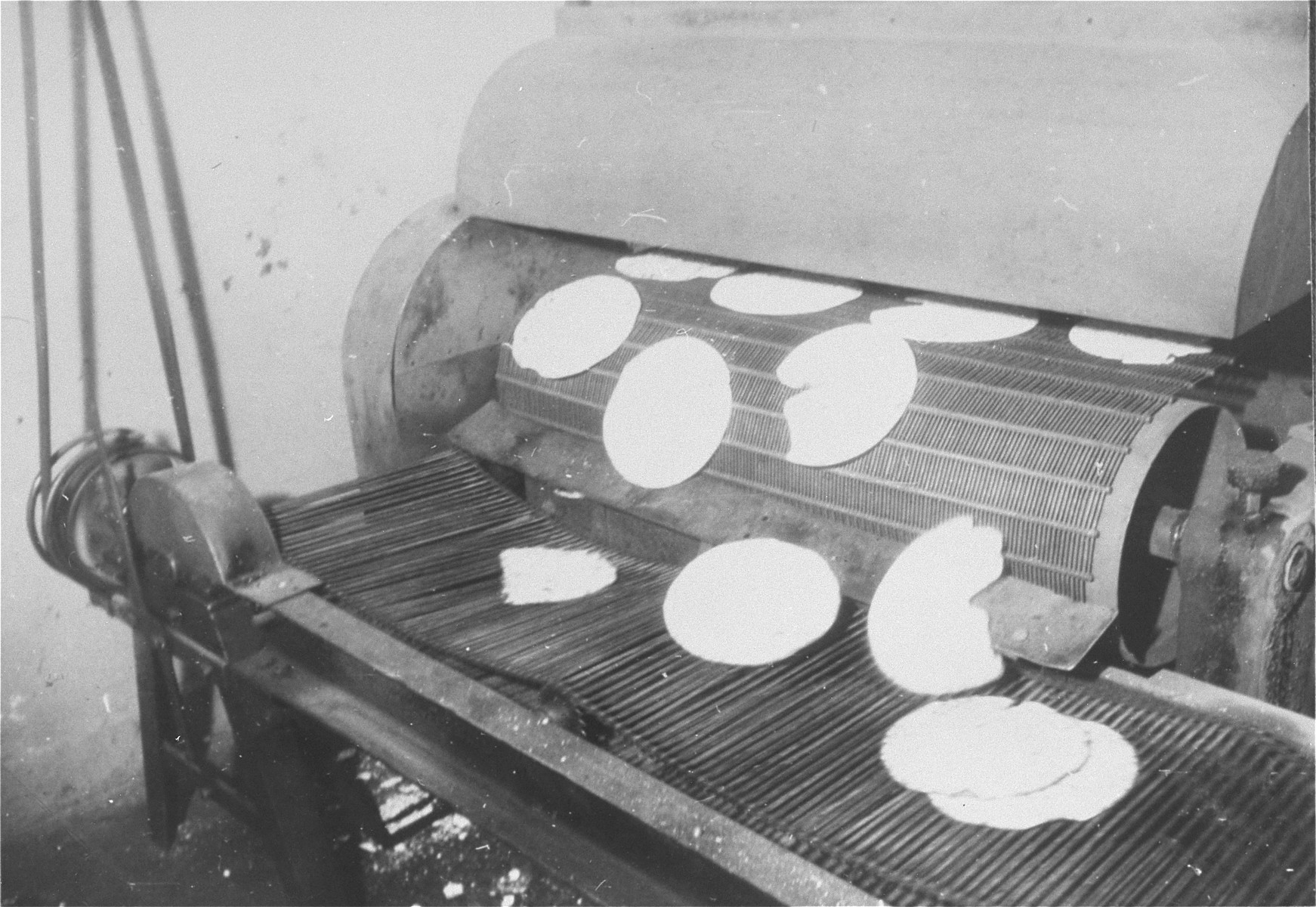 Matzahs come out of the oven at a bakery in Frankfurt that escaped destruction by the Nazis.