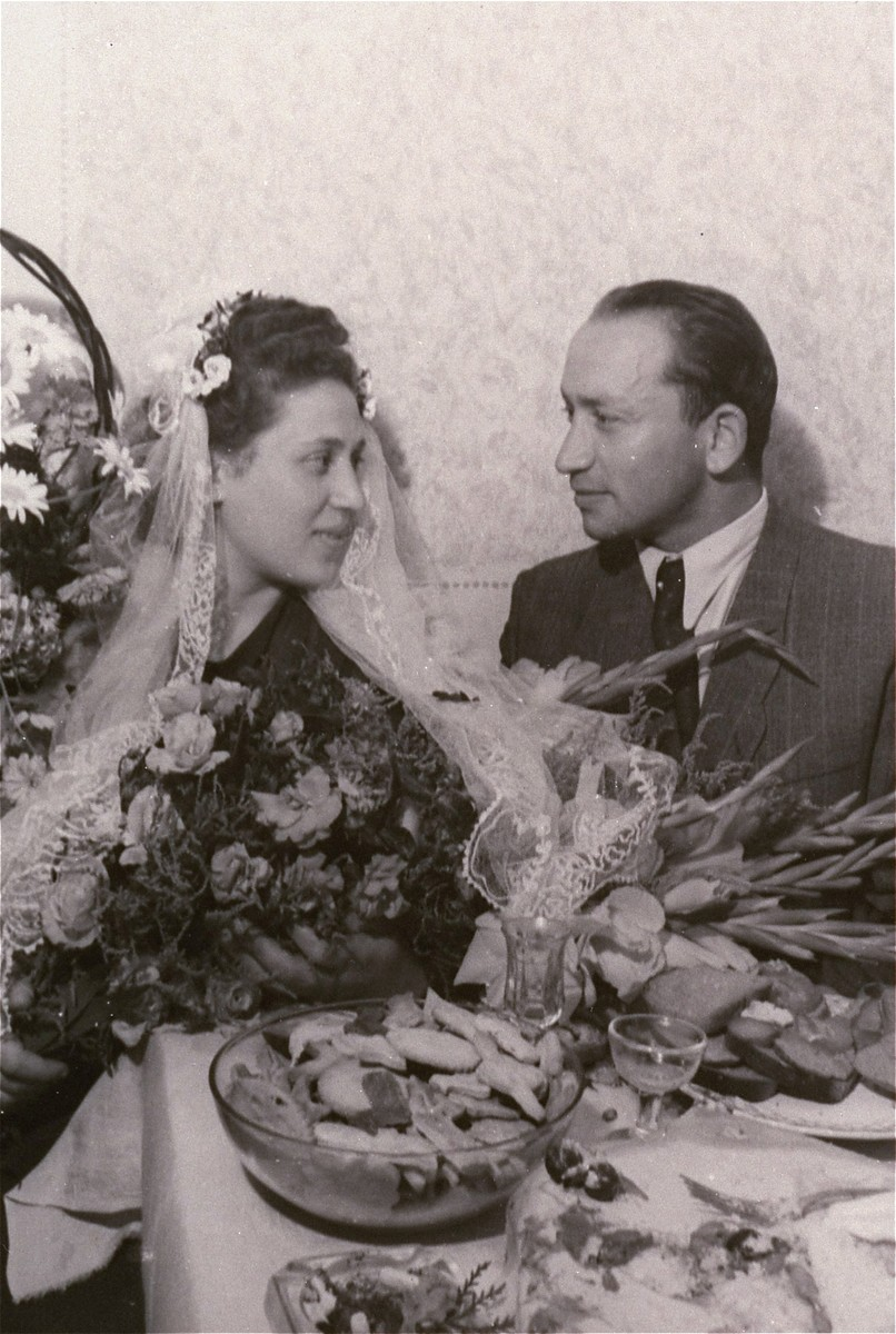 Portrait of a Jewish DP couple at their wedding celebration in the Zeilsheim displaced persons' camp.