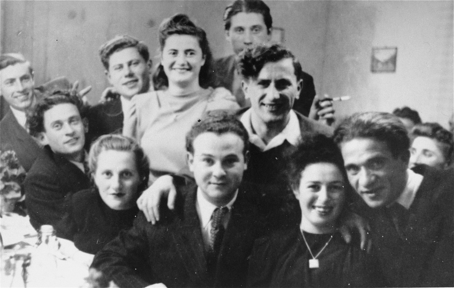 A social gathering at the Foehrenwald displaced persons camp.  Among those pictured are Israel and Ester Korman (second and third from the left), Sam and Regina Spiegel (back row)  David Bajer (standing in the center), and Leon and Rose Badner (first and second from right).  Israel's mother and Sam's father were siblings. Rose and Ester survived the war hidden by a gentile woman in Babice named Petronela Lach [?].