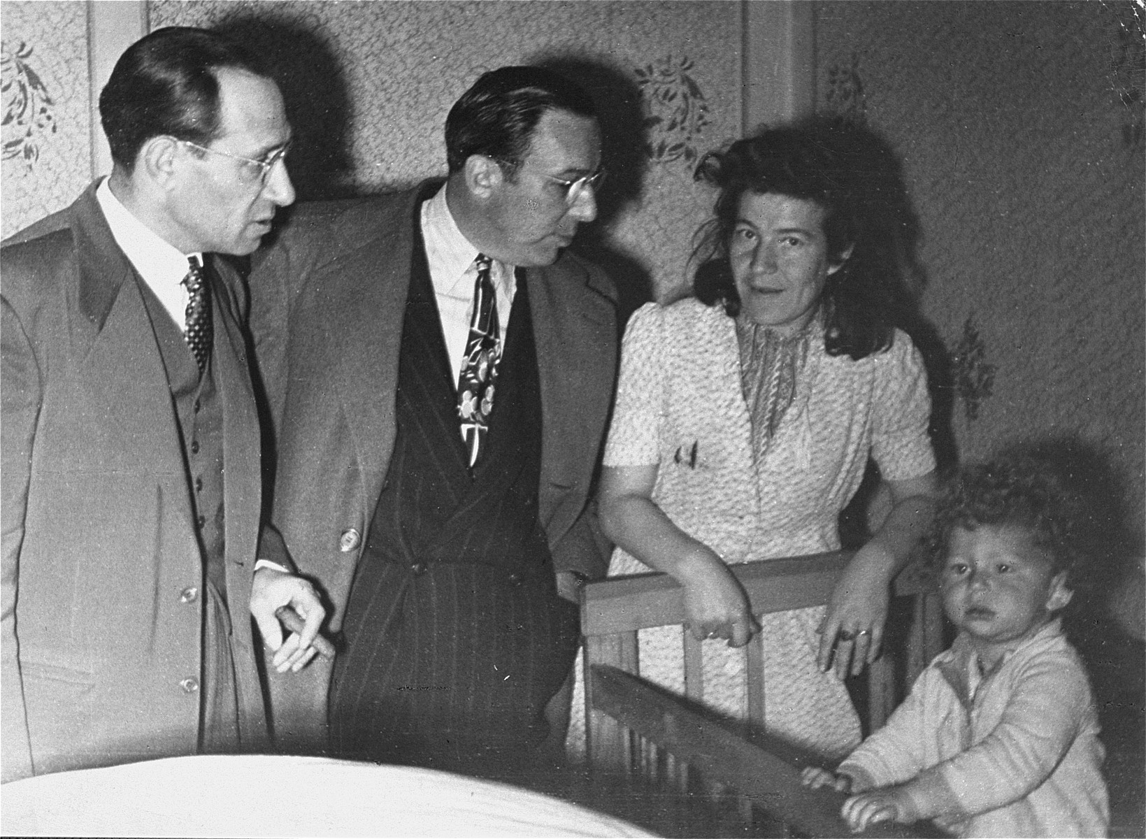 JDC representatives visit child care facilities at the Foehrenwald displaced persons camp.    Among those pictured is Samuel Haber, Director of JDC programs in the U.S. Zone from 1947 until 1954 (left).