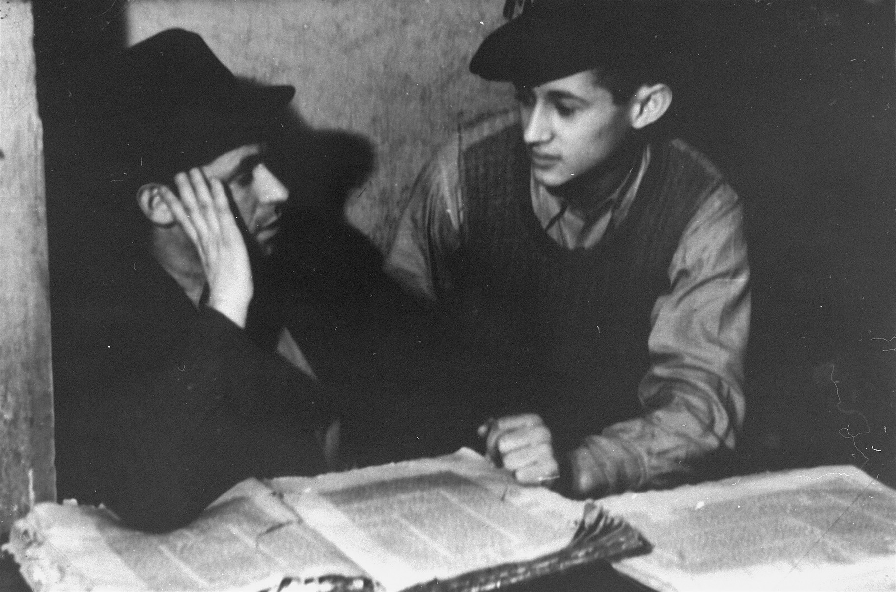 Students study Talmud at a Yeshiva in the Zeilsheim displaced person's camp.