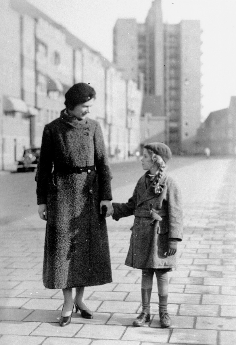 Ilse Ledermann, a German Jewish refugee from Berlin, stands with her daughter Barbara in the Merwedeplein (square) in Amsterdam.  This was the square where the Frank family lived.