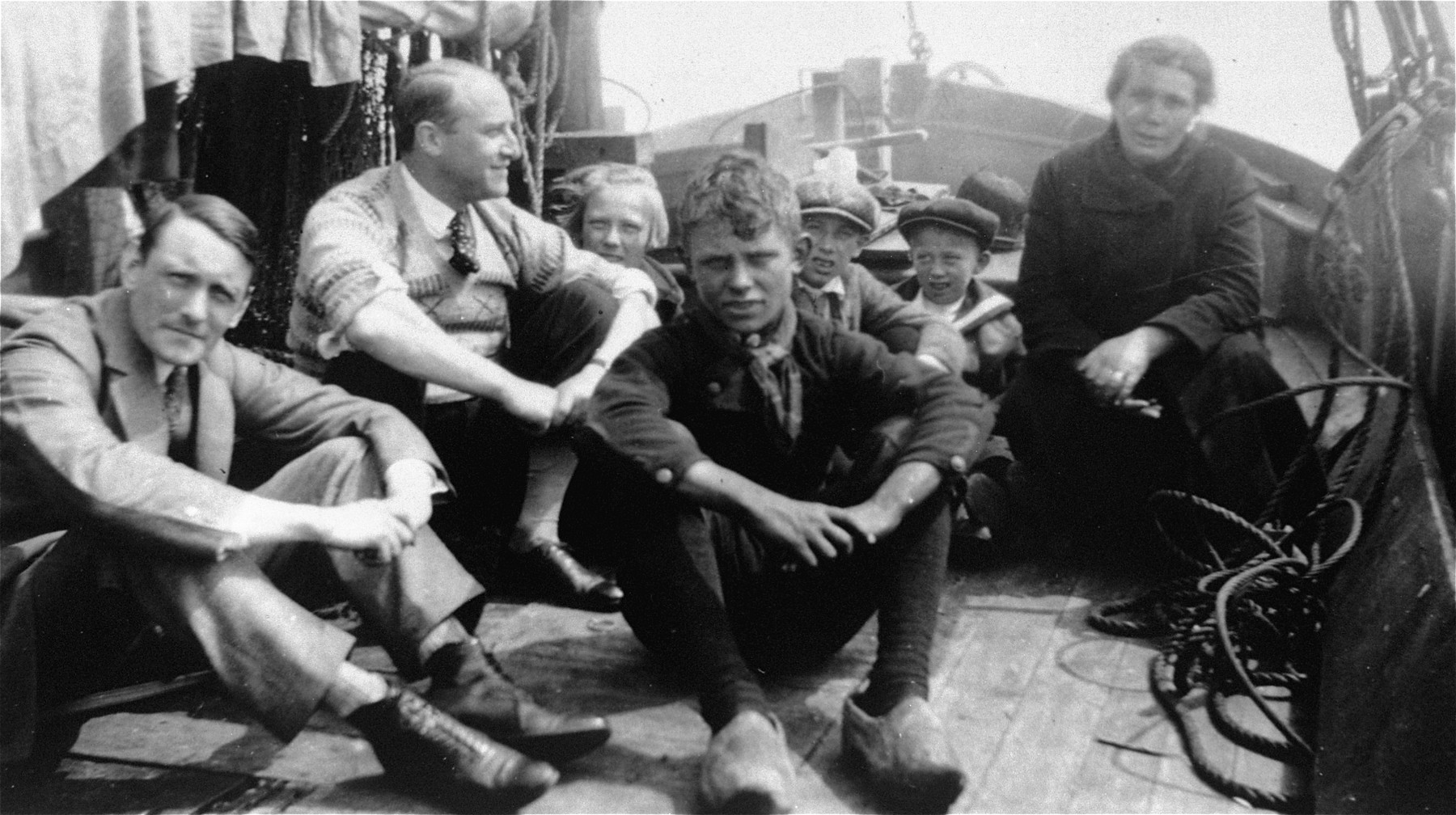 Group portrait of passengers on a ship, among whom is Willem Arondeus.  Later during the war, Arondeus led a gay resistance group in Amsterdam which was responsible for bombing the Amsterdam Population Registry offices.  The attack was carried out on 27 March 1943 in an effort to destroy government records of Jews and others sought by the Nazis.  As a result of the act, Arondeus was executed in 1943.  His rescue efforts have been recognized by by Yad Vashem and the USHMM.