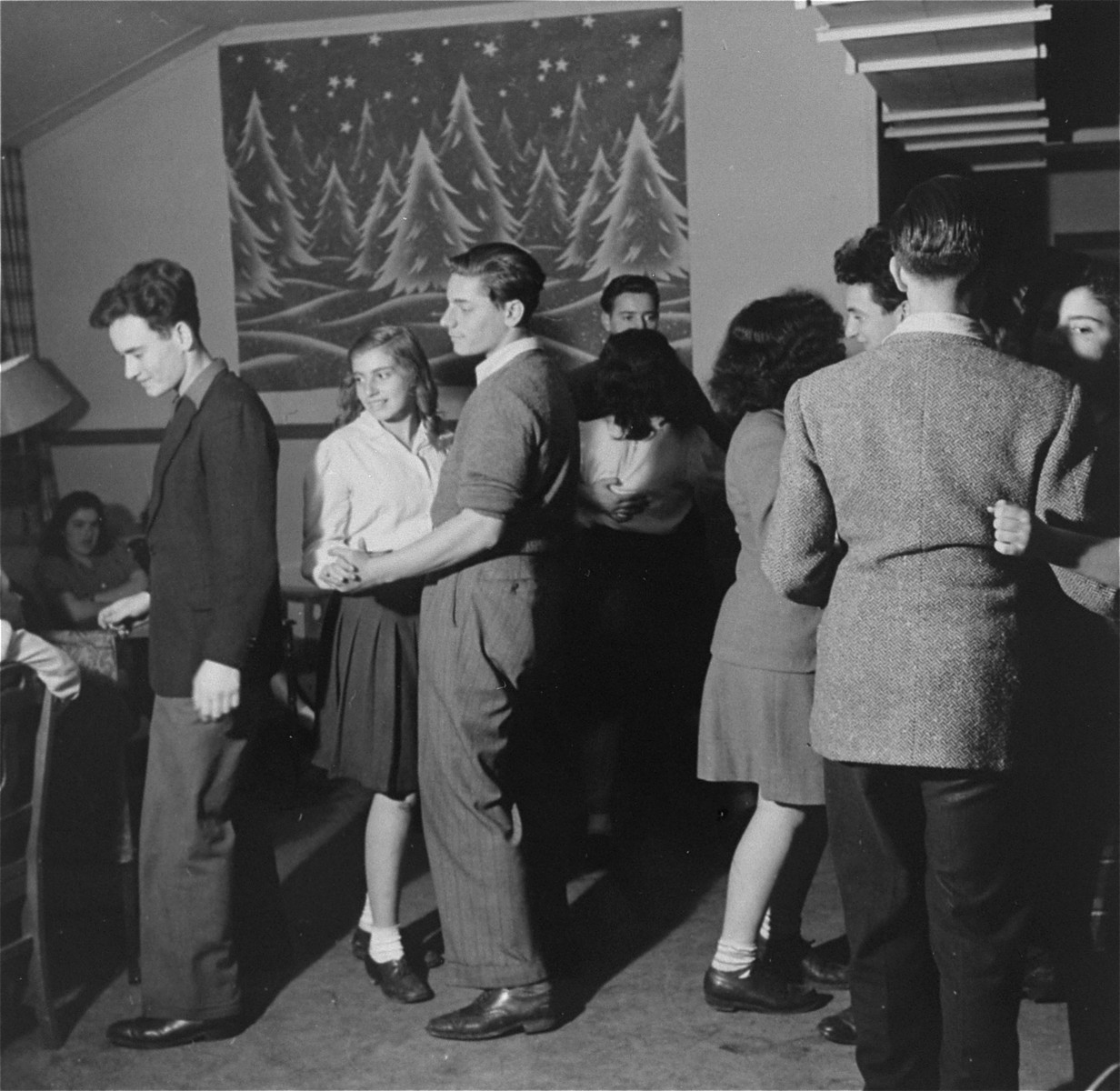 A youth group dance at the Fort Ontario Refugee Center.  Among those pictured left to right are David Hendel, Dorit Reisner, Koki Levi (from Yugoslavia), Adam Munz and [Ivo Lederer].