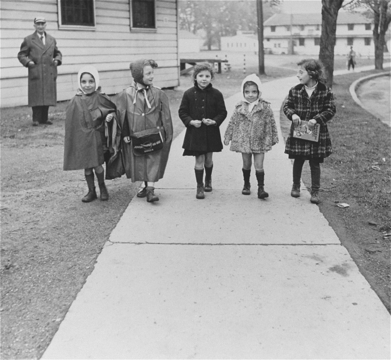 Young children return from school.    All children attended school but had to return to the refugee center after school.  Suzanne Krauthamer is in the center.