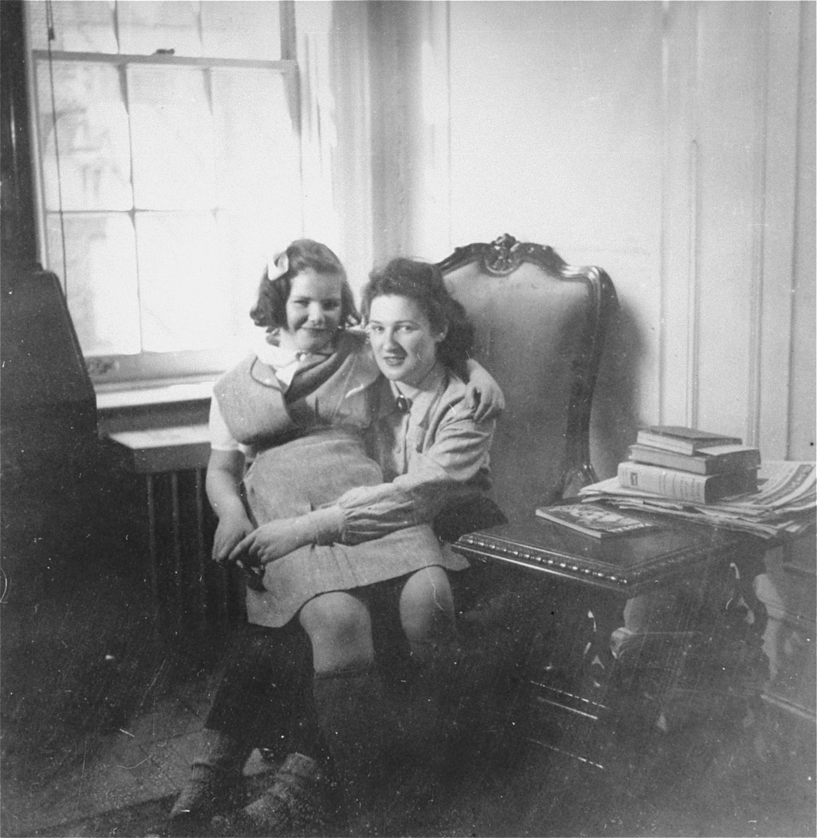 Two Jewish sisters who survived the war hiding in France, pose in their room shortly after their arrival in the United States.   Pictured are Jacqueline Glicenstein with her younger sister, Josette,
