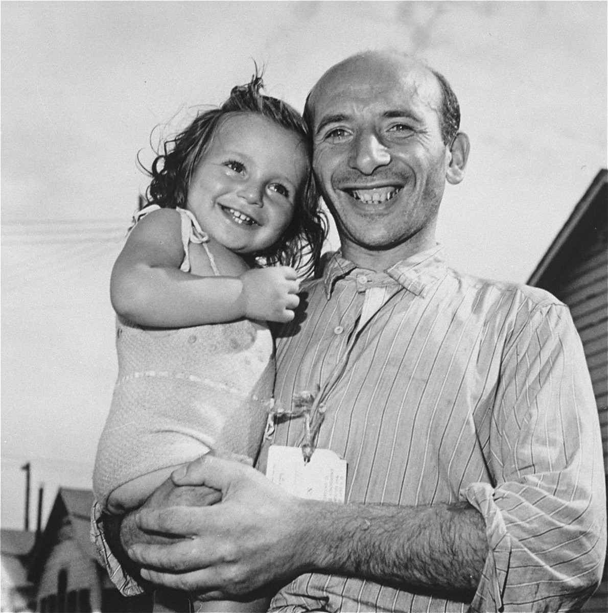 Jacob Waksman wirh his daughter in the Fort Ontario Refugee Center.