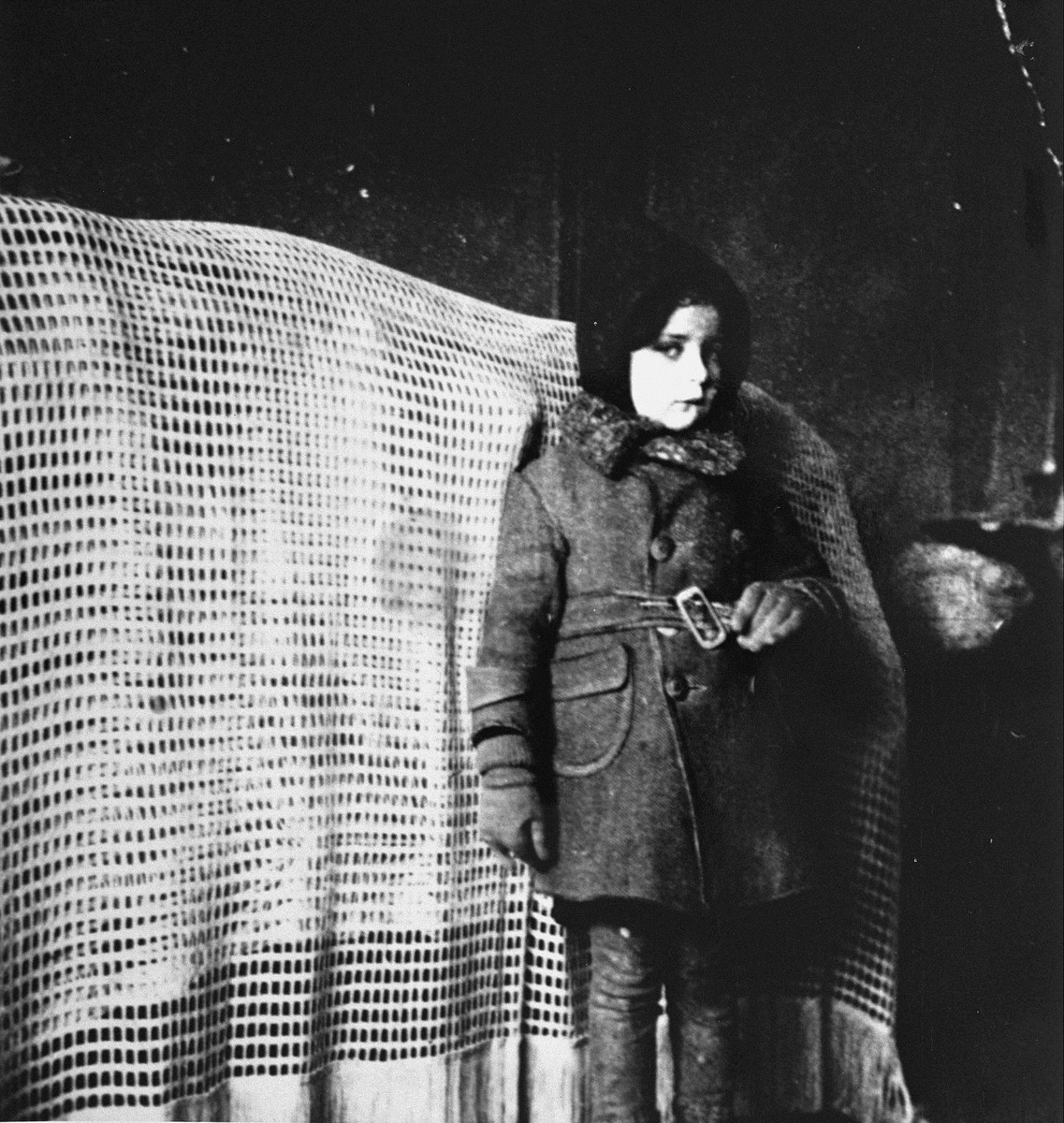 Portrait of a Jewish child, who had survived the war in hiding, in Lodz soon after the liberation.   Pictured is Romana Schreier