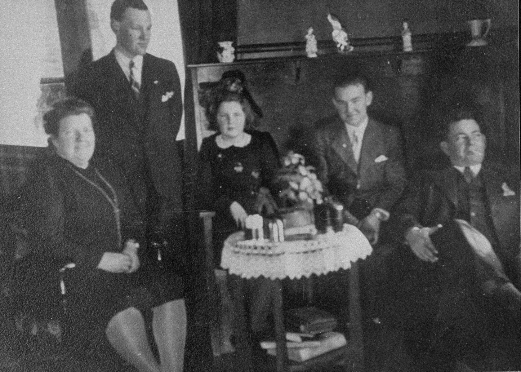 Portrait of a Dutch family who hid Jews during the war.    Pictured are Hank Hornsveld, his wife, and their three children,  who offered their house as a hiding place for Flory and Felix Van Beek. Fleeing the Gestapo the Van Beeks knocked on their door in the middle of the night of January 21, 1944 and stayed until the end of the war.
