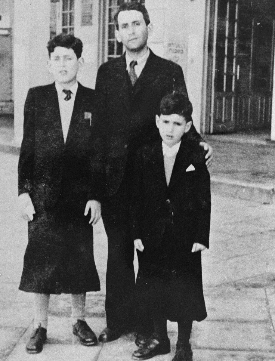 Jacob and David Gutgeld pose with their father after being reunited in Palestine after the war.