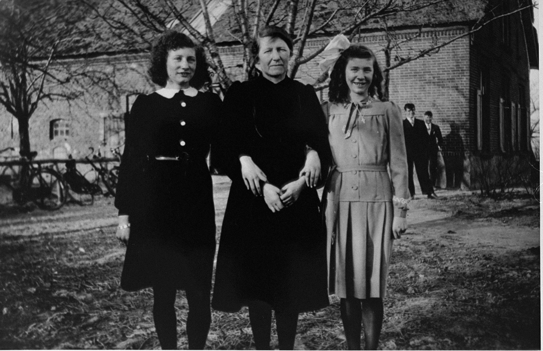 "Marion Kaufmann visits the Beelen family farm for the last time before her immigration to the United States.    The Beelens hid Marion during the war. From left to right: Grada Beelen, Wilhelmina ""Moeke"" Beelen, and Rie Beelen."