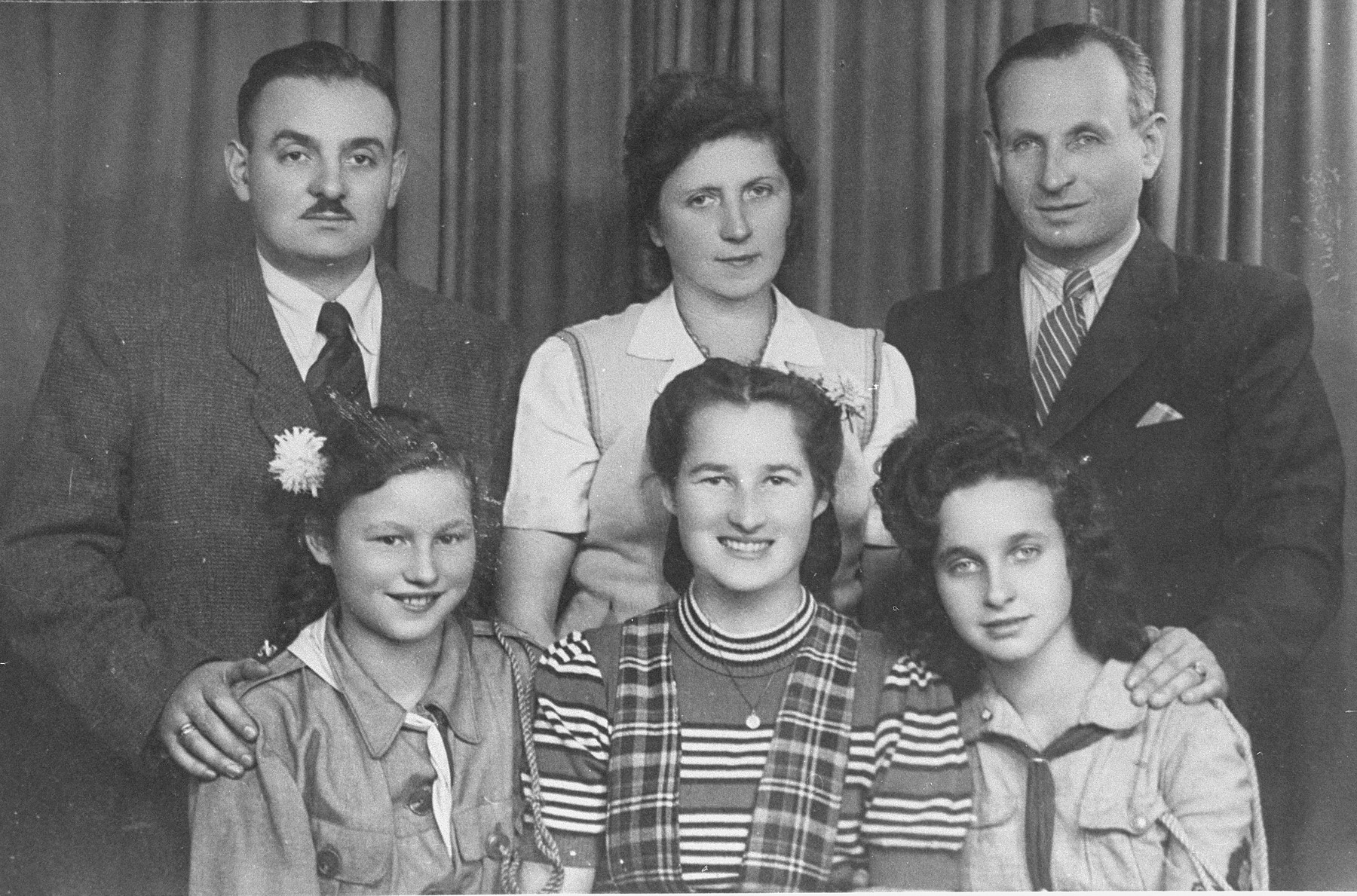 Polish rescuer Stefania Podgorska Burzminski poses with Jews she rescued during the German occupation of Poland.  Pictured in the front row from left to right are: Helena Podgorska, Stefania (Podgorska) Burzminski and Judy Shylenger.  In the back row from left to right are: Joe Burzminski, Mr. Shylenger and Mrs. Shylenger.