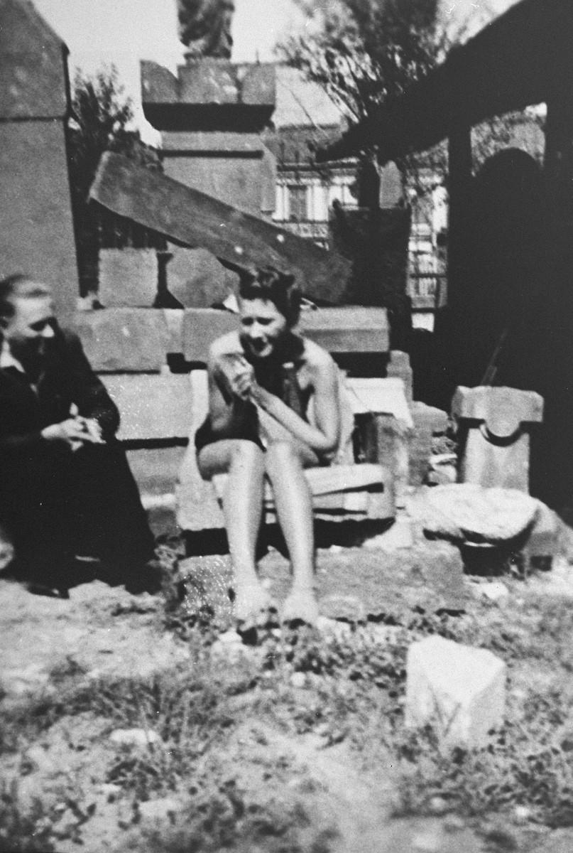 Zofia Baniecka sits outside with a friend.