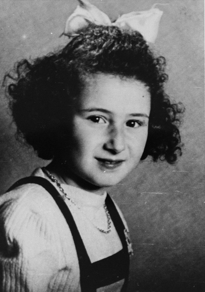 Portrait of Marion Kaufmann, age nine, taken at the home of her rescuers shortly before her reunification with her mother.