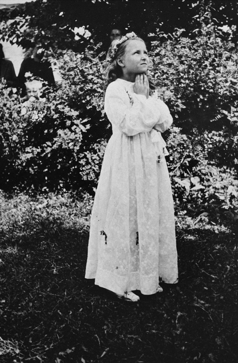 Portrait of a Jewish child dressed for her First Communion.  Pictured is Selma Schwarzwald, who had lived in hiding as a Polish Catholic during the war.