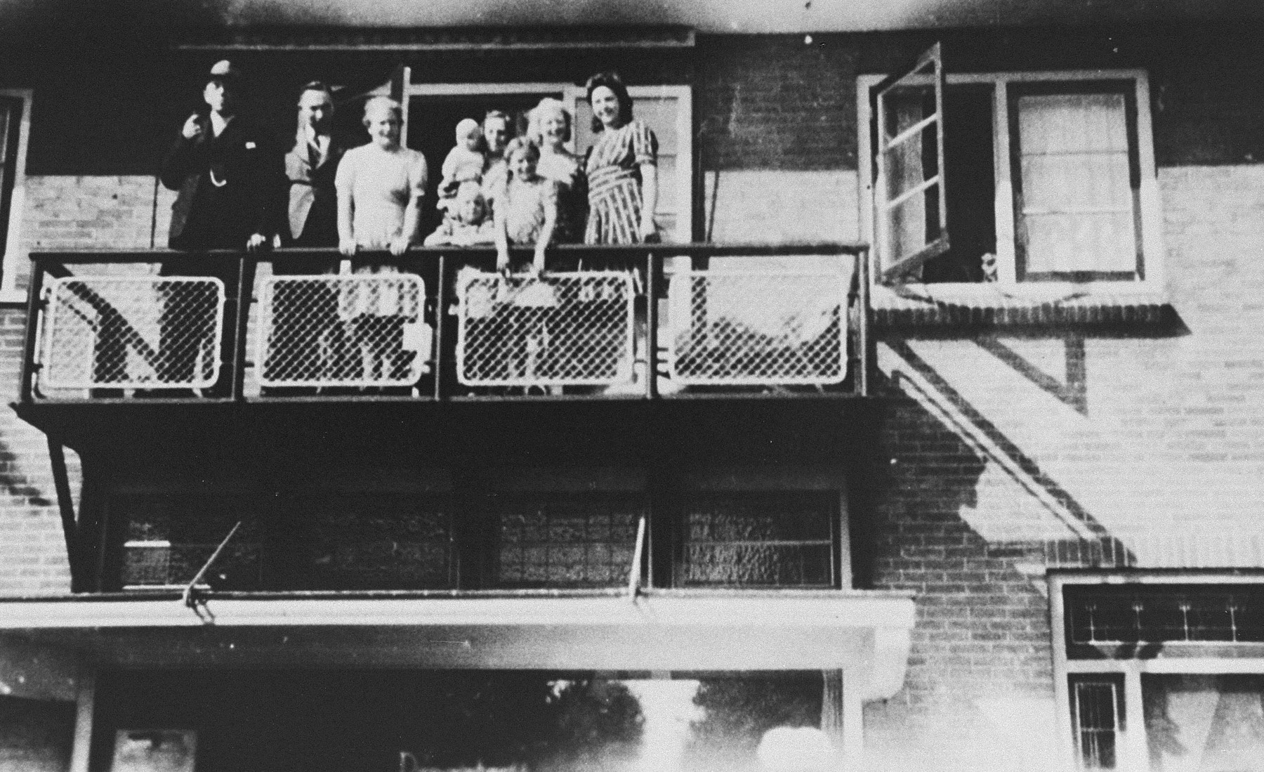 Friends pose on a balcony built by Bert Bochove,  adjacent to the attic where he hid 37 Jews.