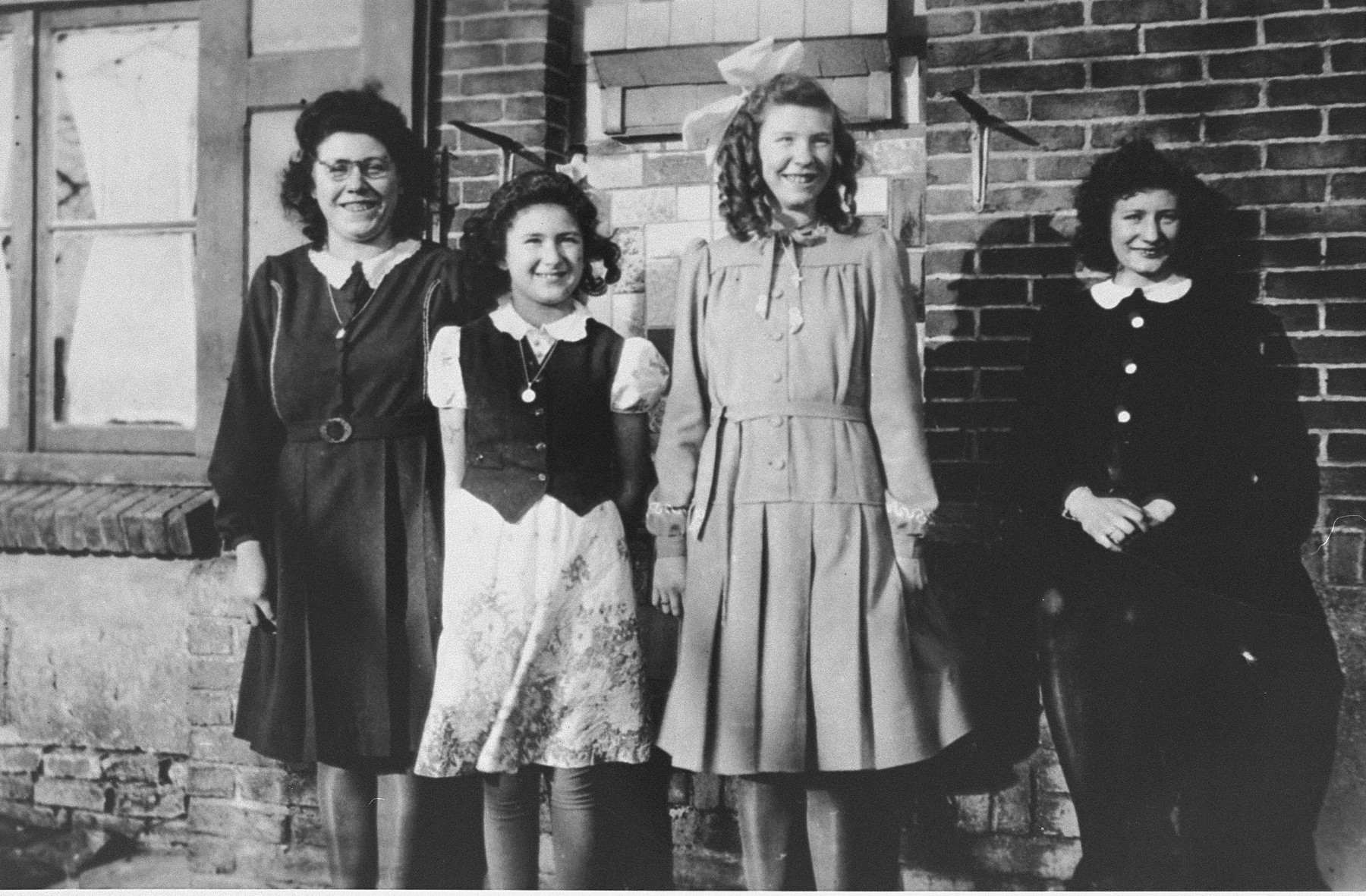 Marion Kaufmann visits the family who hid her during the war.   She made this last visit before her immigration to the United States. From left to right are: Marie Beelen, Marion Kaufmann (who was hidden under the name Renie Beelen), Rie Beelen, and Grada Beelen.