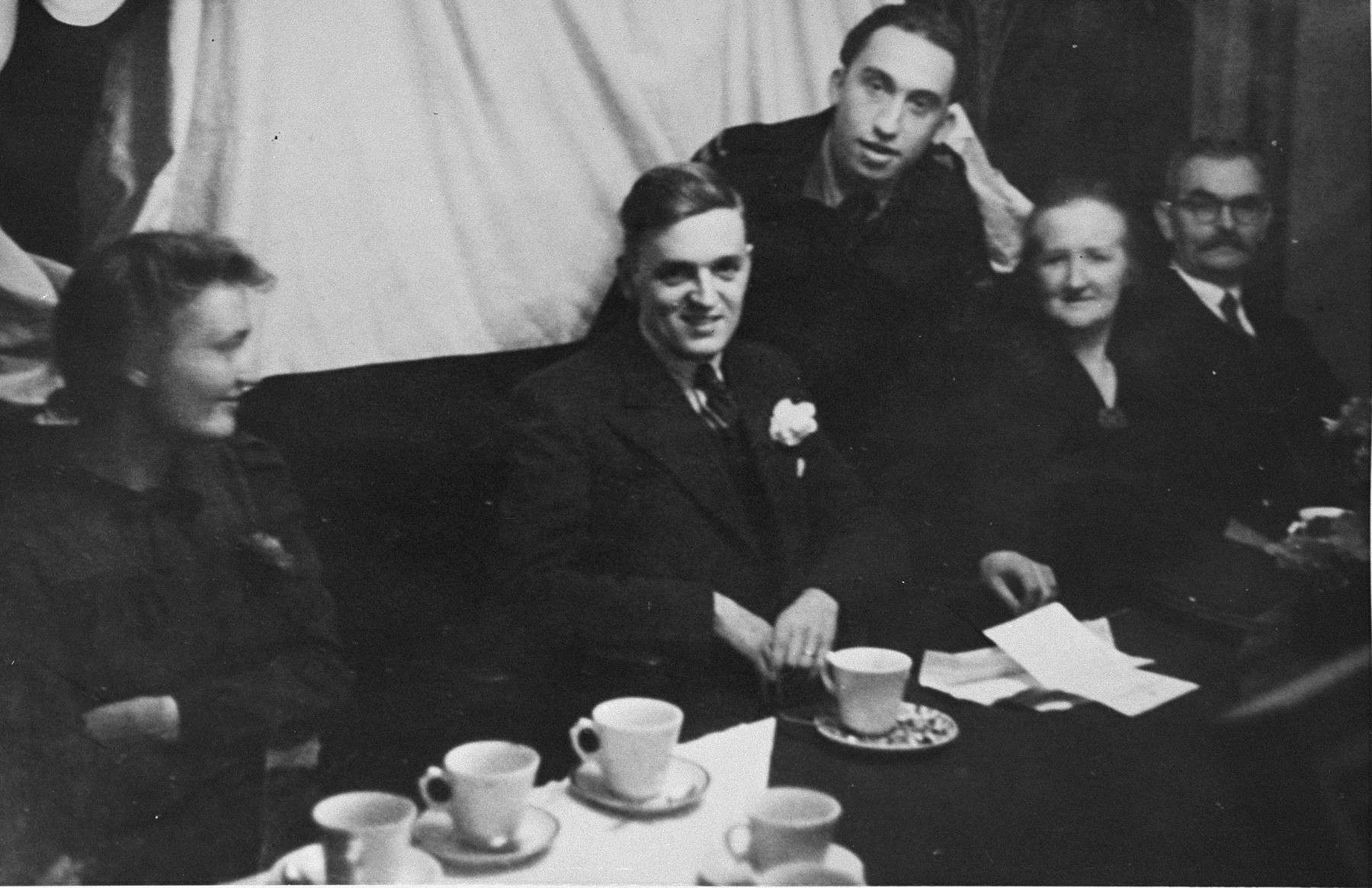 Fritz Freilich (standing) poses with members of the van Mansum family who hid him during the German occupation of Holland.  Pictured seated are Arie and Margaretha van Mansum and their parents.