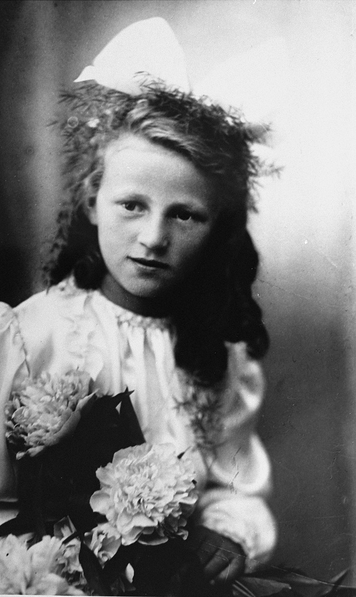 First communion portrait of Guta Tyrangiel, a Jewish child who had survived the war in hiding with a Polish family.