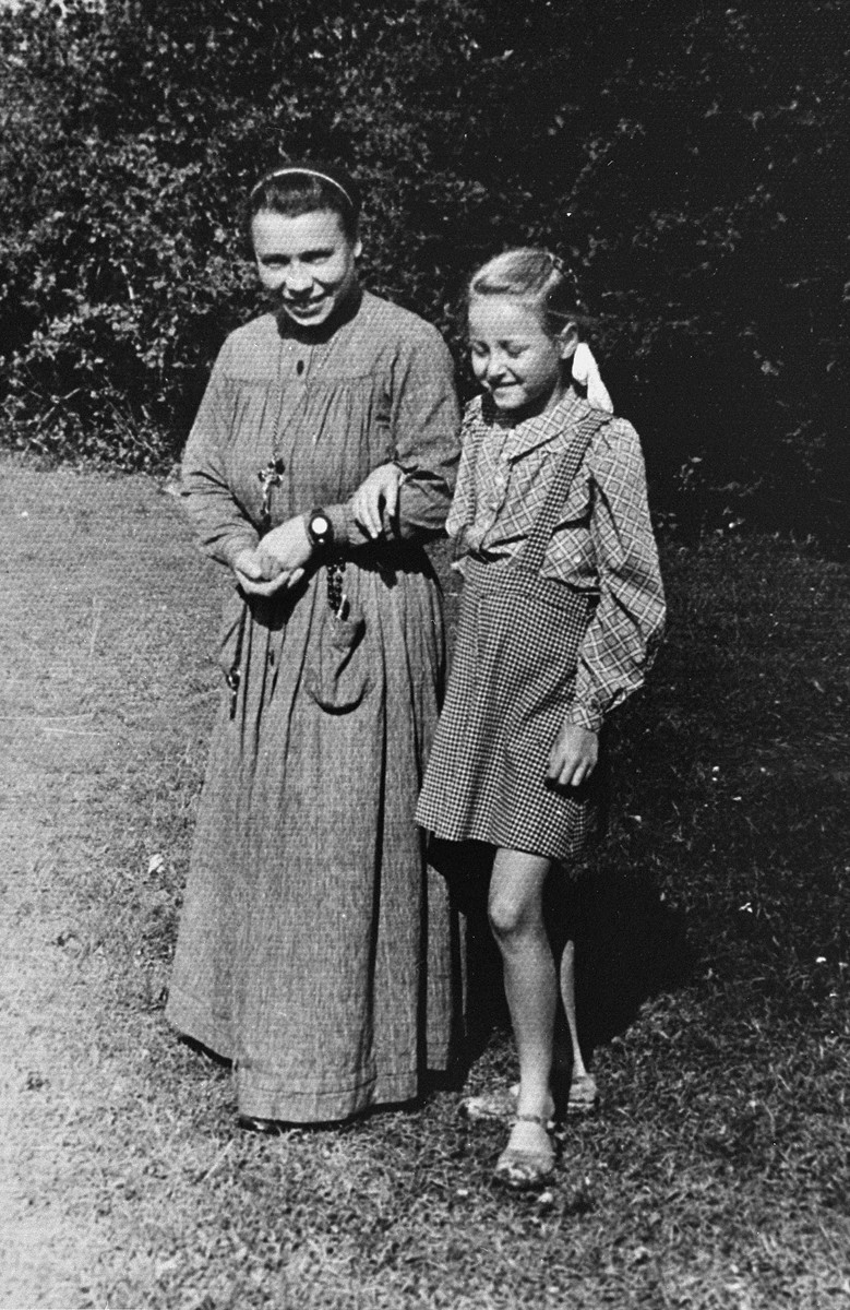 Selma Schwarzwald poses with a novice nun at a summer camp for orphaned children at a convent in Rabka, Poland.  Selma is a Jewish child who lived in hiding as a Polish Catholic during the war.