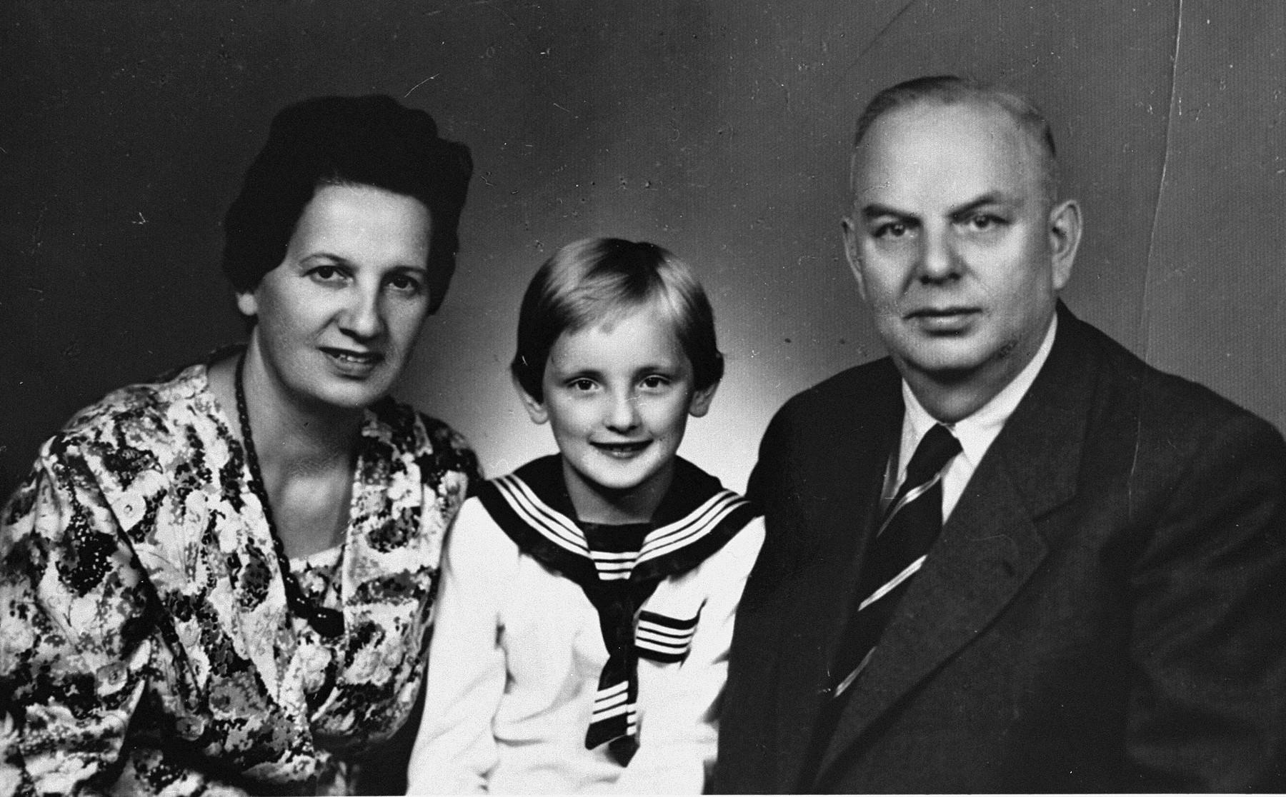 Rescuers Wiktoria and Stanislaw Szumielewicz pose with their child.