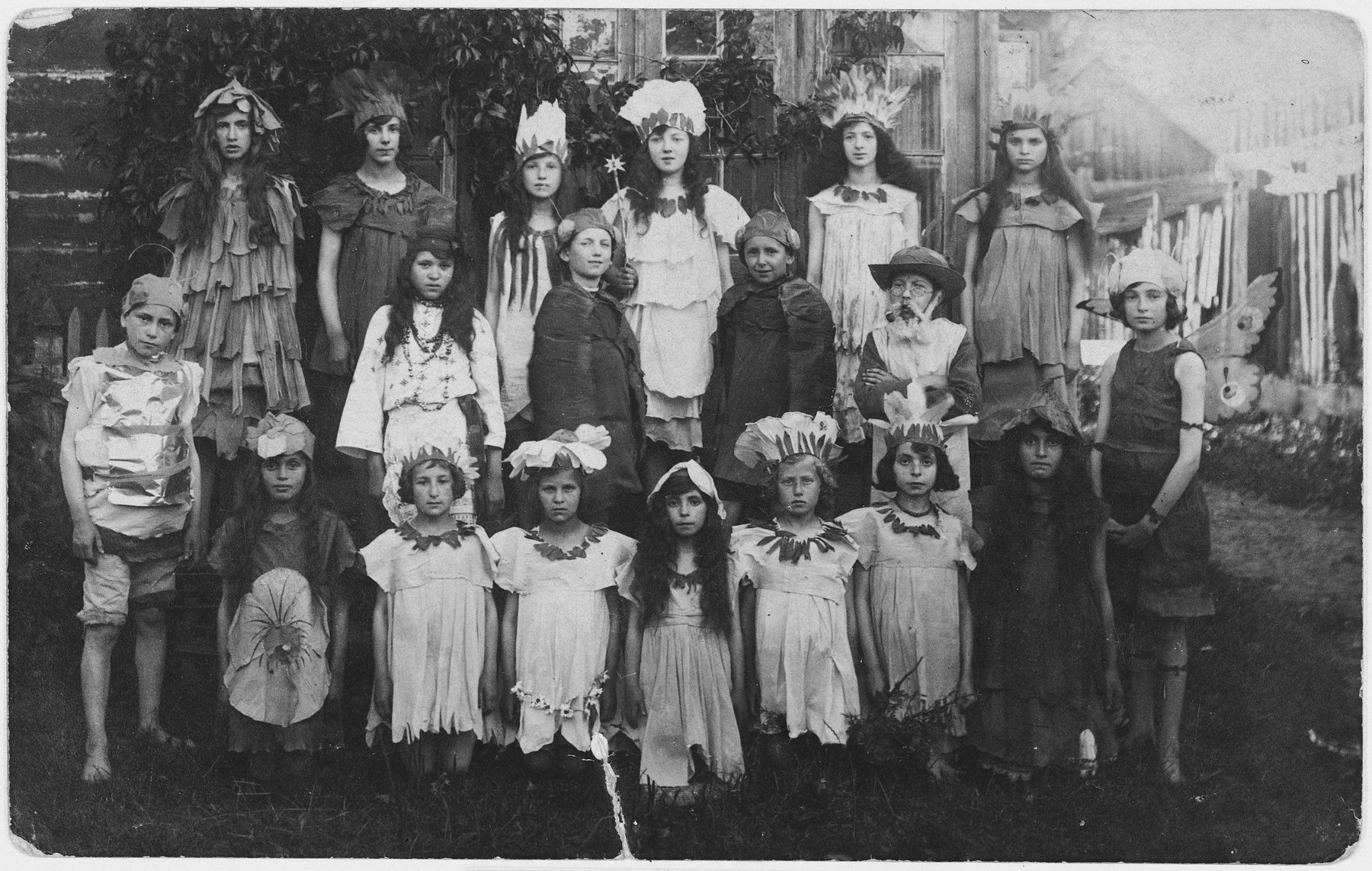 """Children in the Yiddish school in Bielsk perform the play, """"Among the Flowers"""".  Genia Kac is standing at the back, fourth from the left."""