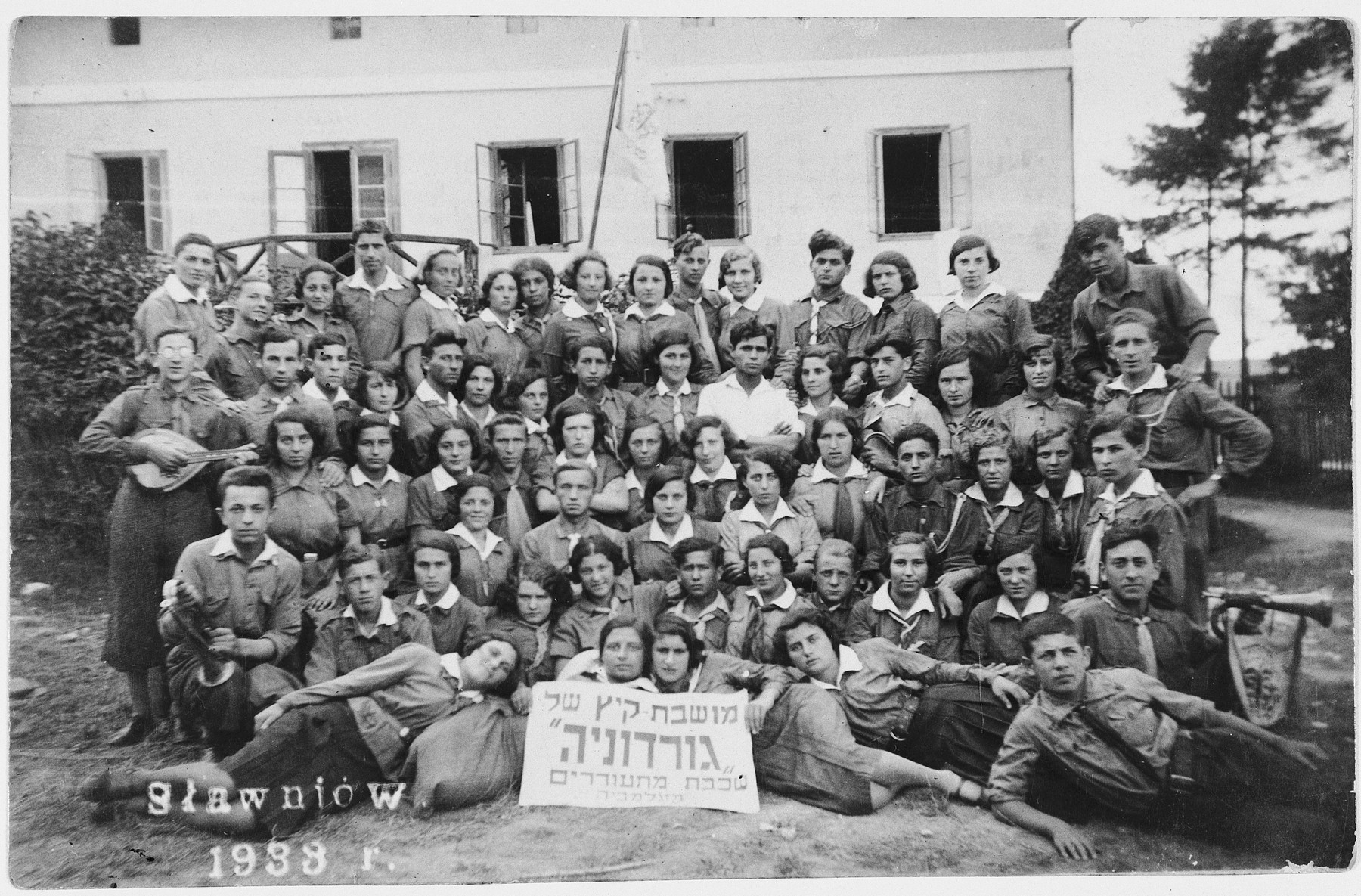 Group portrait of members of the Gordonia Zionist youth movement at a summer camp in Slawniow, Poland.