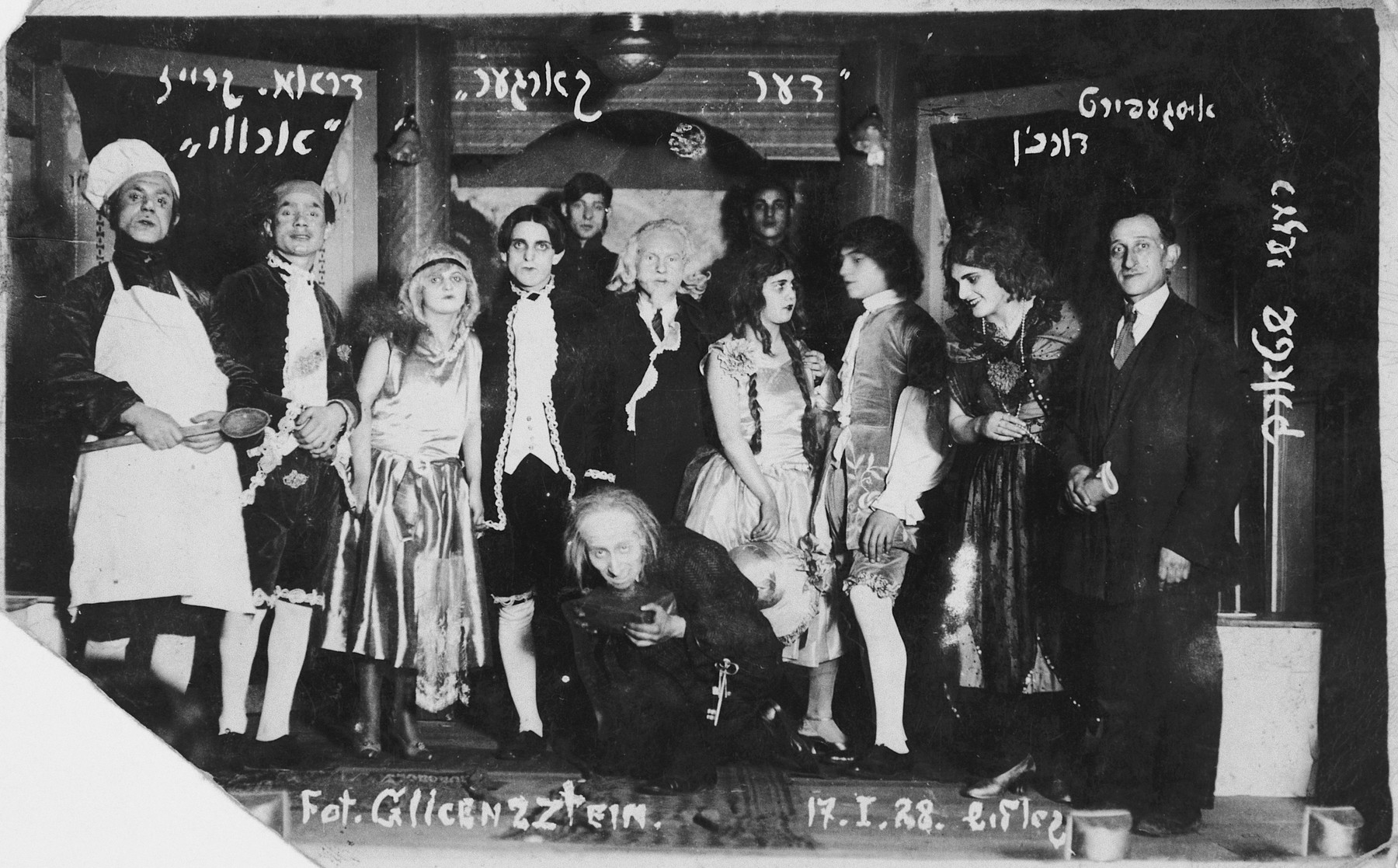 """Members of the Bundist theater group """"Arvi"""" perform the Moliere's """"The Miser"""" in Yiddish.  Heniek Storch (crouching center) plays the lead role and also directed the production.  Also pictured are Szmerling (extreme right), Nissenboym, David Lezerowicz, I. Kac (Szlamowicz) and Yakub Kac."""