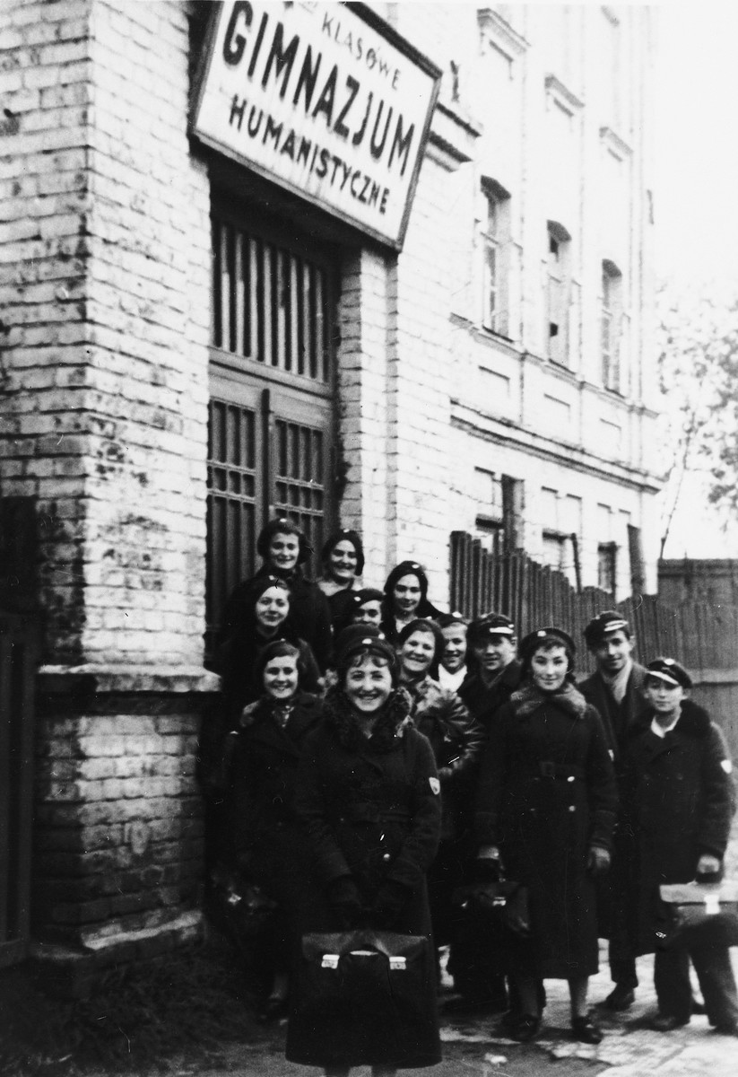 Students wearing school uniforms pose outside the Epstein Polish Gymnasium.  Among those pictured (back row, far left)  is Adele Grynholtz (now Adele Jochelson), who attended Epstein Gymnasium until 1938.