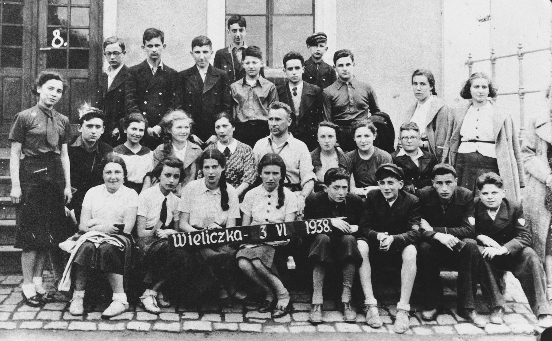 Students at the Epstein Polish Gymnasium.  Vera Shapiro is standing on the far right.  Julian Rafes is the tallest boy in the back row.