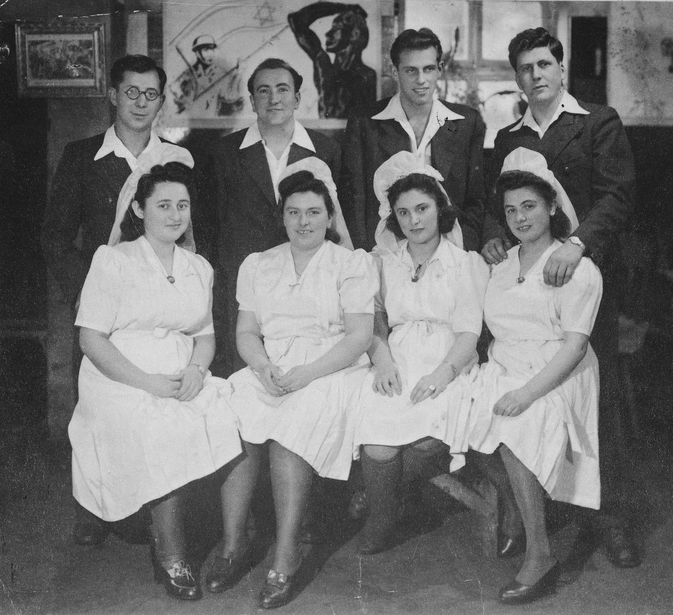 Group portrait of four couples at the Kibbutz Buchenwald hachshara (Zionist collective) in Geringshof, Germany, who are about to be married.  Pictured from left to right are Szymon and Hana Szmulewicz; Wajsman and his bride Rozka; Moniek and his bride Dora; and Gershon and Malka Belkowski.