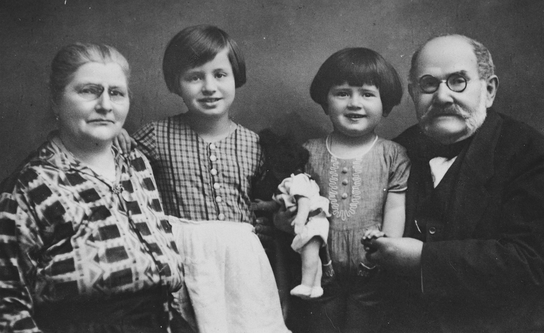 Portrait of the Loeffler family.  From left to right are Marie Loeffler, her grandaughters Mitzi and Susanna, and Ignatz Loeffler.