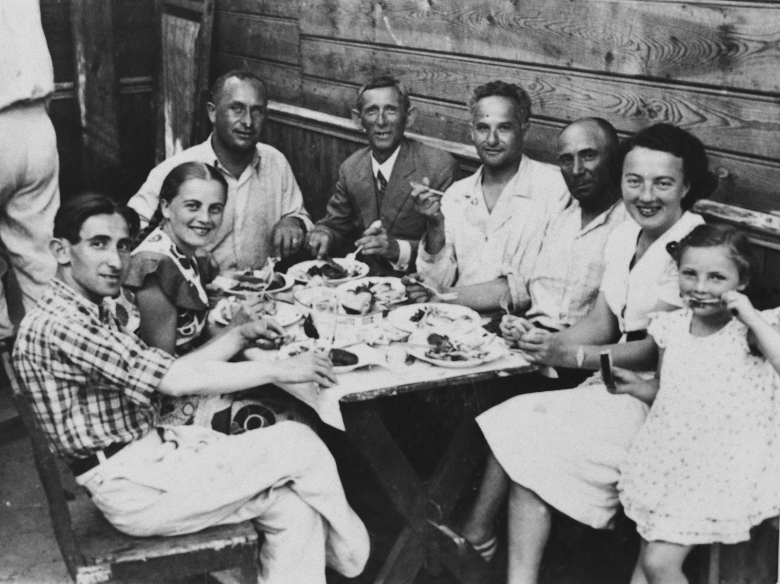 The Storch family vacations with friends in the Chelmski guesthouse in Domaczewo.  Heniek Storch is on the left.  Genia and Helena are seated on the right.