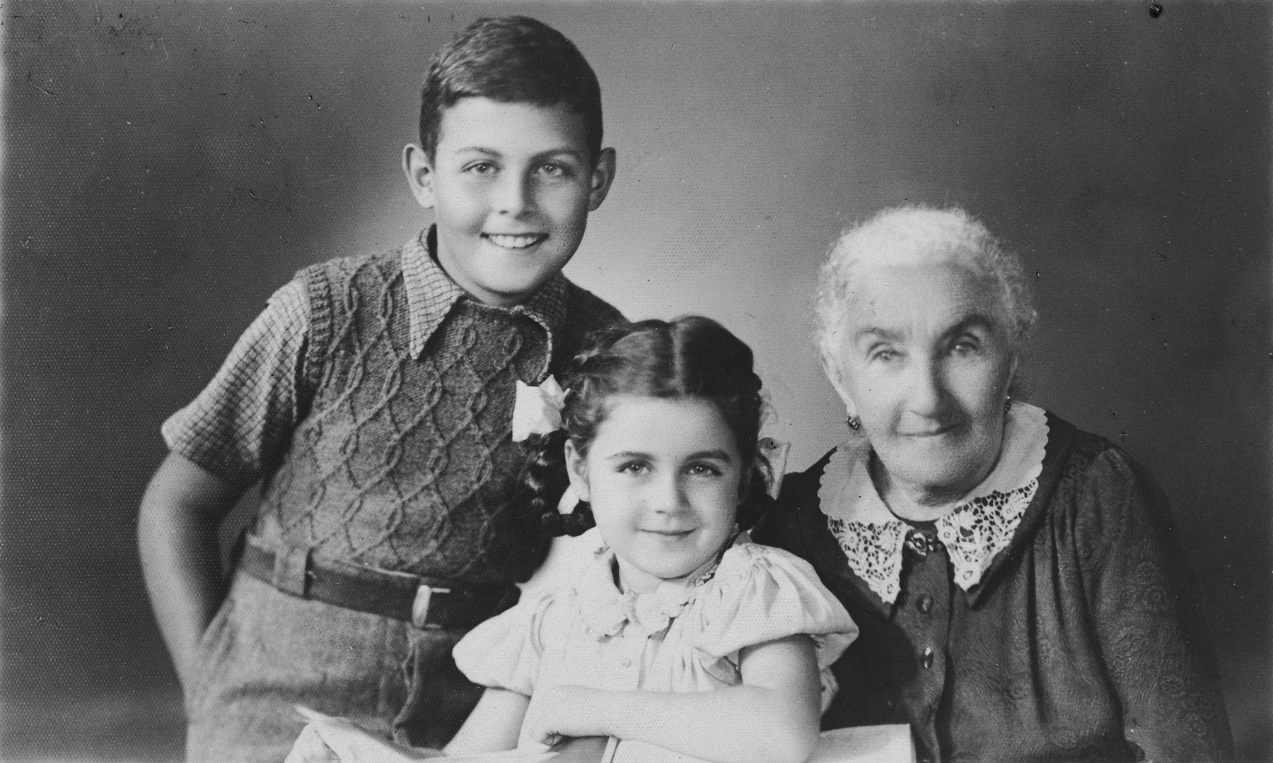 Portrait of the Ponevejsky family in Shanghai.  Pictured is the mother of Anatole Ponevejsky together with Greg and Mona, the children of his sister.
