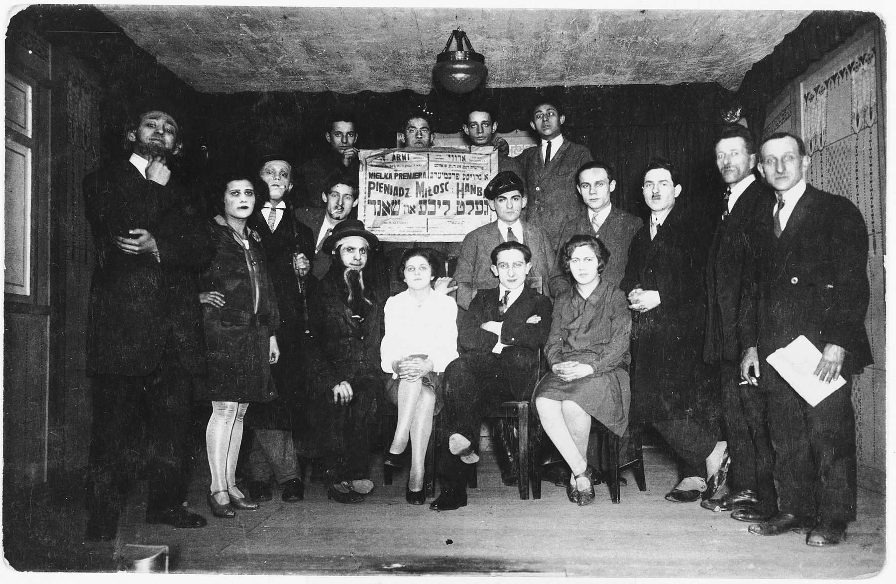"Members of the Bundist theater group ""Arvi"" perform the ""Money, Love and Shame"".  Heniek Storch (seated first row, second from right) directed the production.  Also pictured is Szmerling (extreme right)."