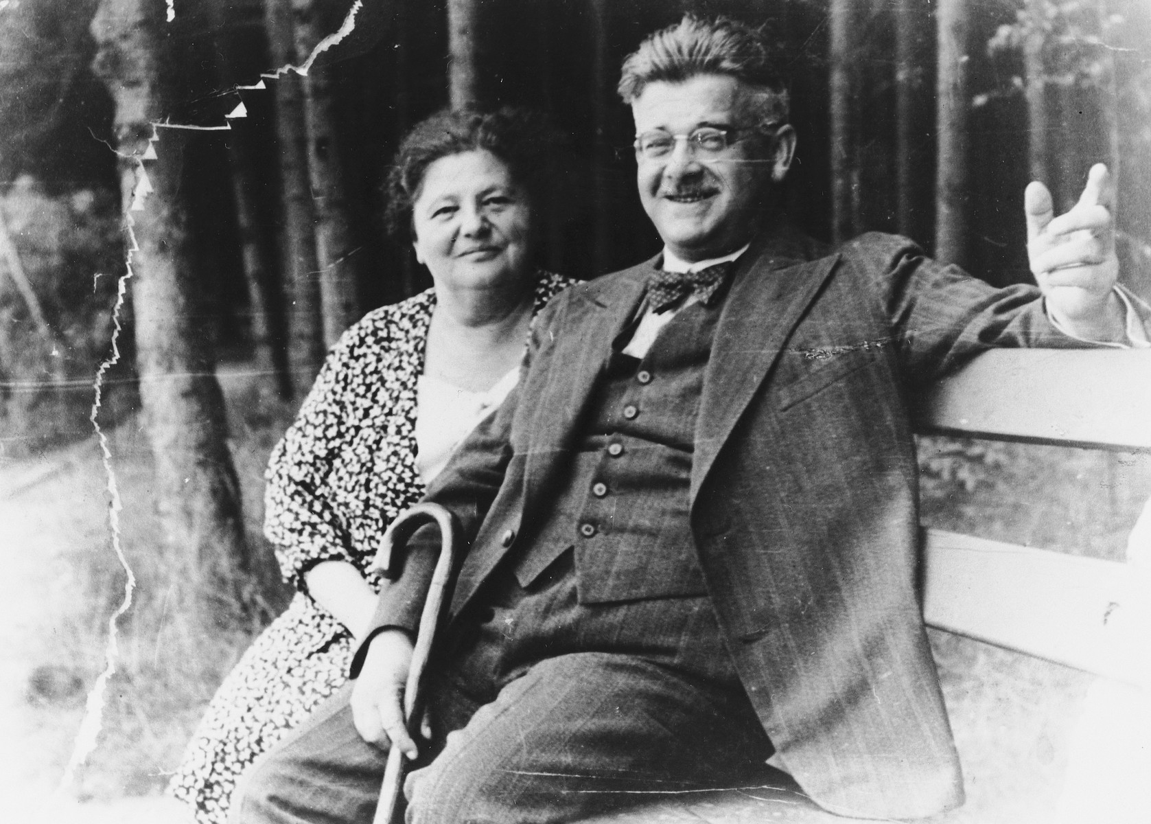 A Czech-Jewish couple sits on a park bench.  Pictured are Stephan and  Alice Loeffler.  Both later perished in Auschwitz.