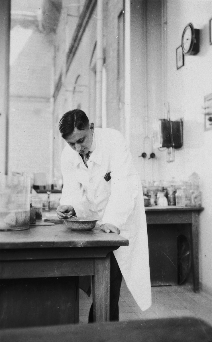 A Jewish physician mixes a medication in his laboratory.  Pictured is Walter Keller.