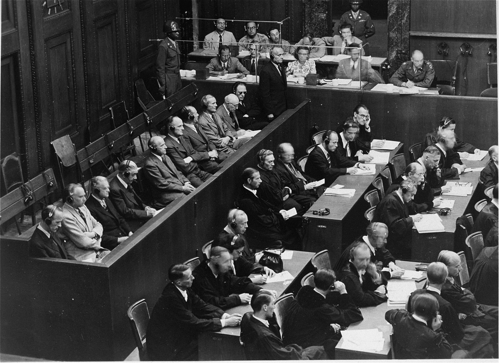 The defendants (left) and their legal counsel in the courtroom during the Krupp Trial.