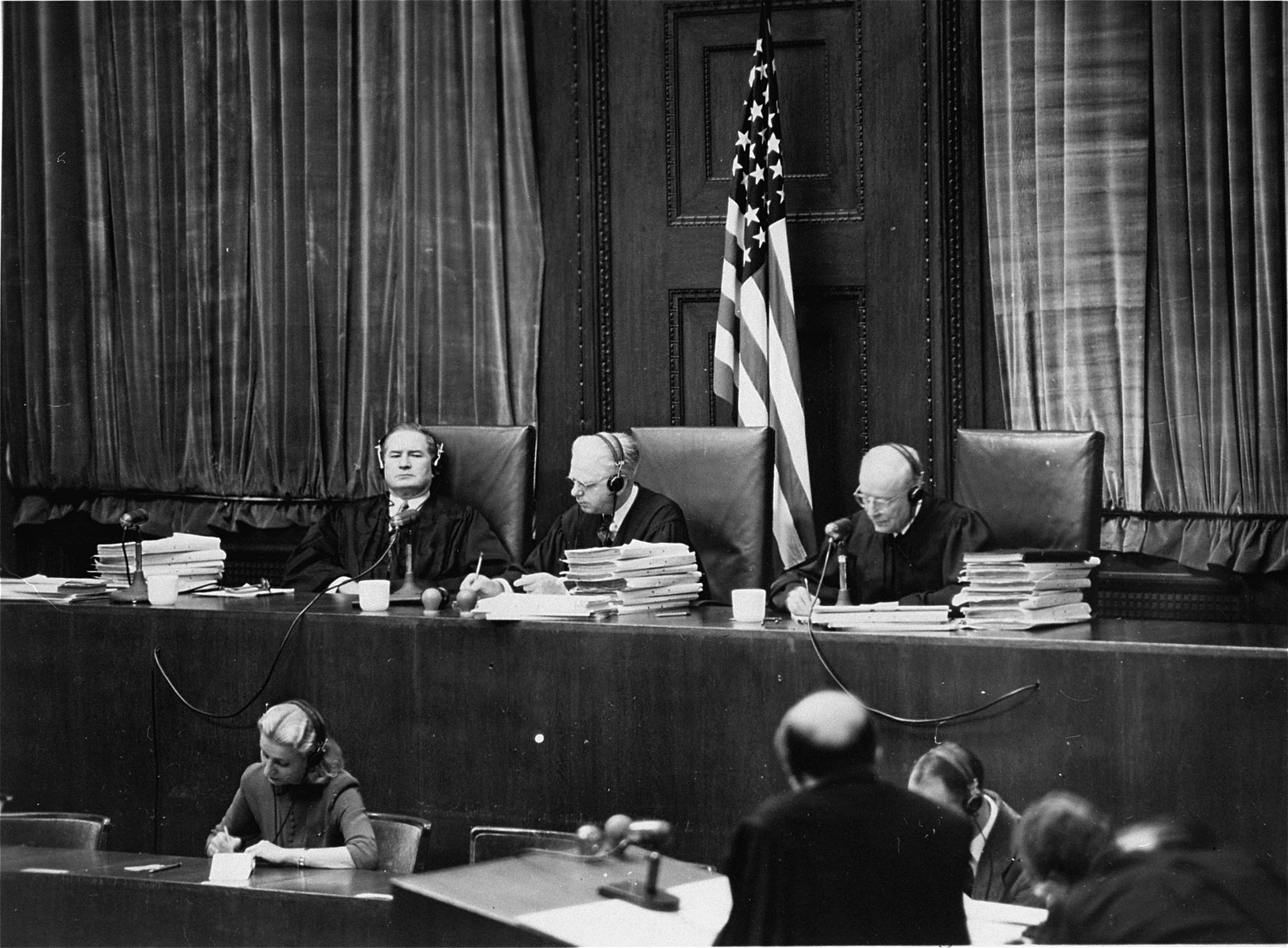 The members of the Tribunal at the Ministries Trial.  Seated from left to right are Leon W. Powers, Presiding Justice William C. Christianson, and Robert T. Maguire.