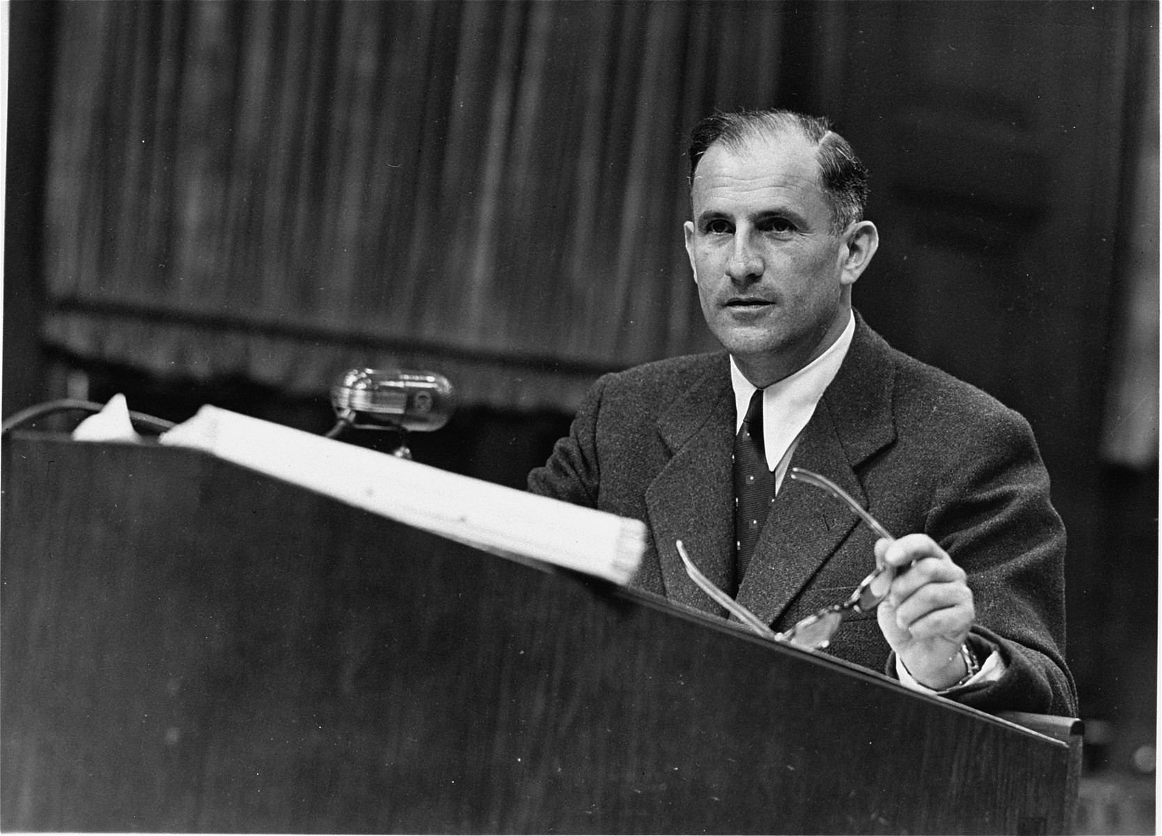 Dr. Robert M.W. Kempner, the Deputy Chief Counsel and Chief of Prosecution's Political Ministries Division, at the speaker's podium during the Ministries Trial.