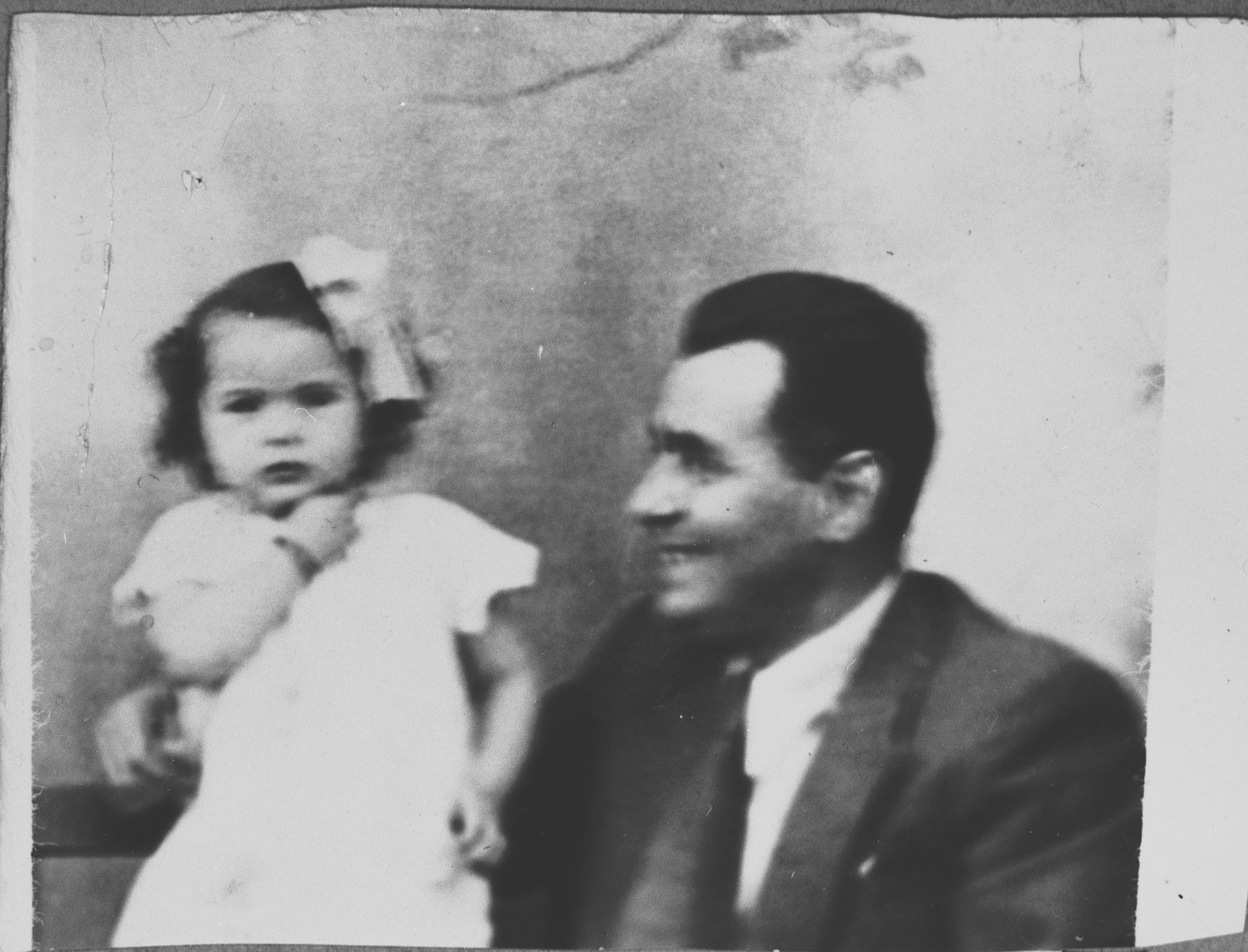 Portrait of Mois Kamchi, son of Solomon Kamchi, with a child.  Mois was an auto dealer.  He lived at Karagoryeva 107 in Bitola.