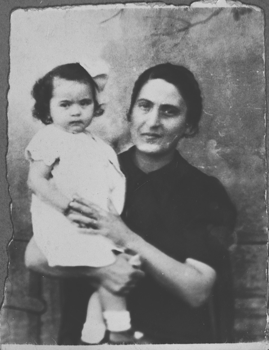 Portrait of Luna Kamchi, wife of Mois Kamchi, with a child.  She lived at Karagoryeva 107 in Bitola.