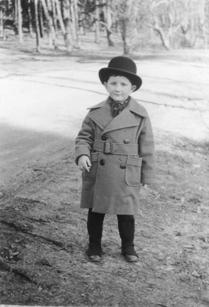 Ivar Segalowitz wearing a bowler and trenchcoat.