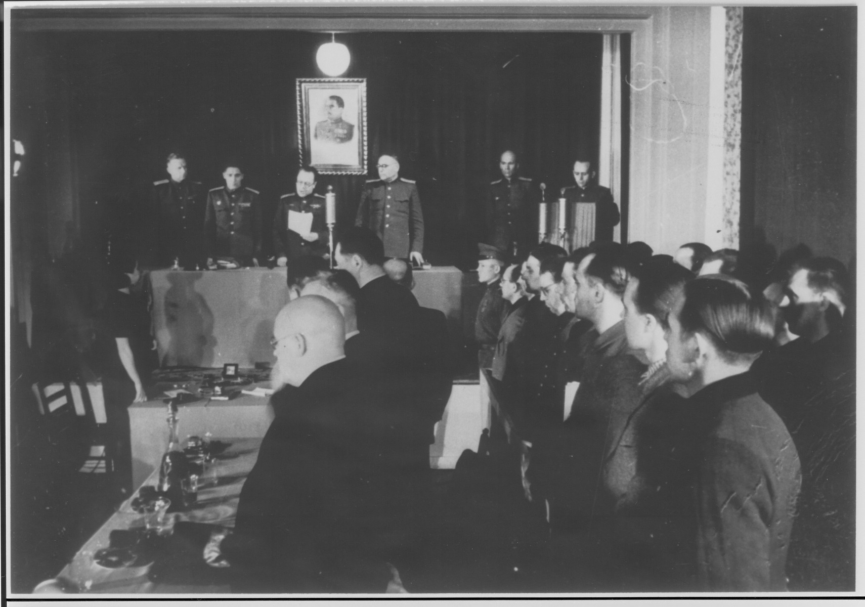 The head of the Soviet Military Tribunal reads a statement to the defendants and their lawyers at the Sachsenhausen concentration camp war crimes trial in Berlin.